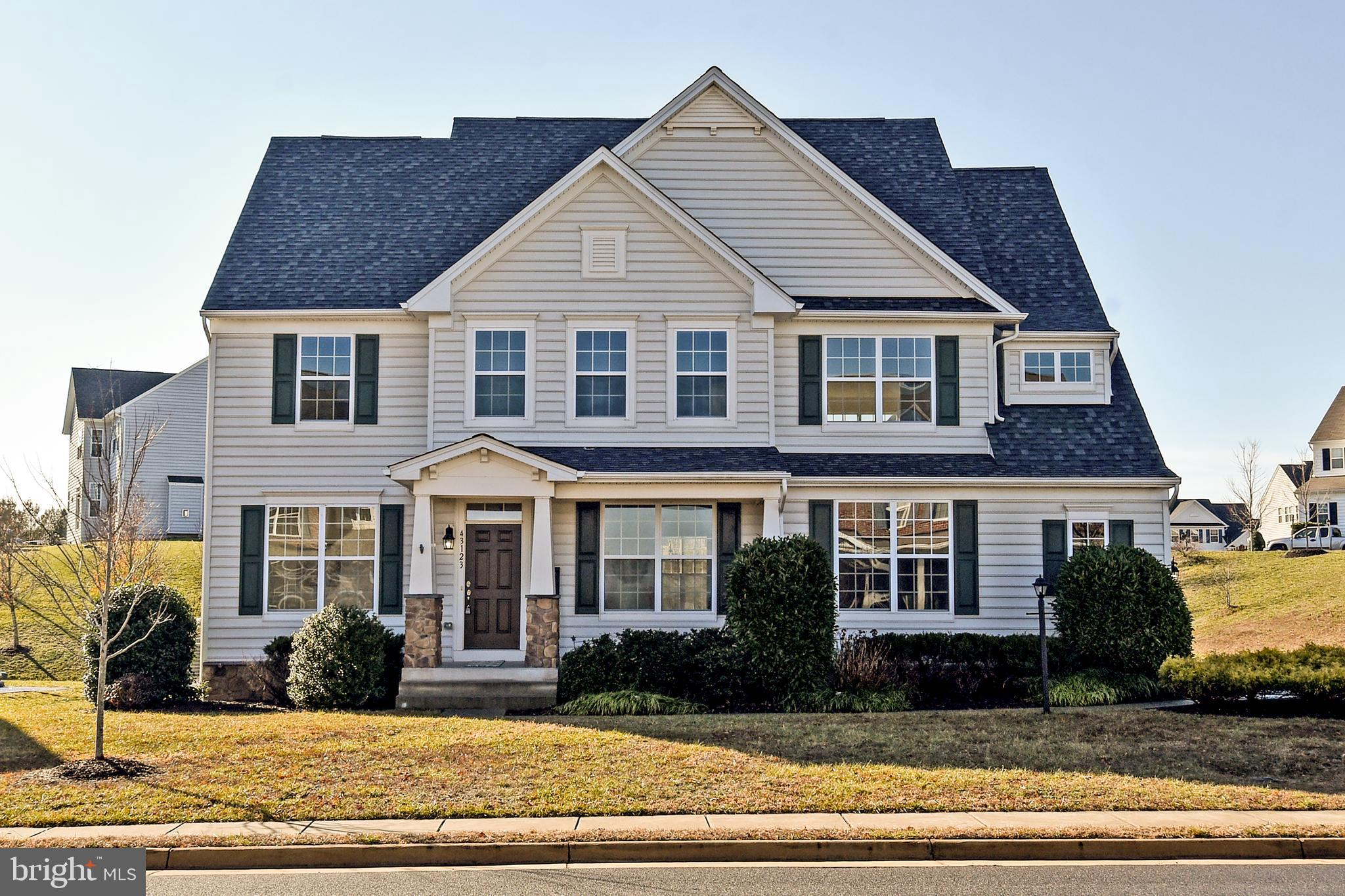 Ideal, this Colonial Kingston II Model welcomes you with an inviting front porch and sophisticated a