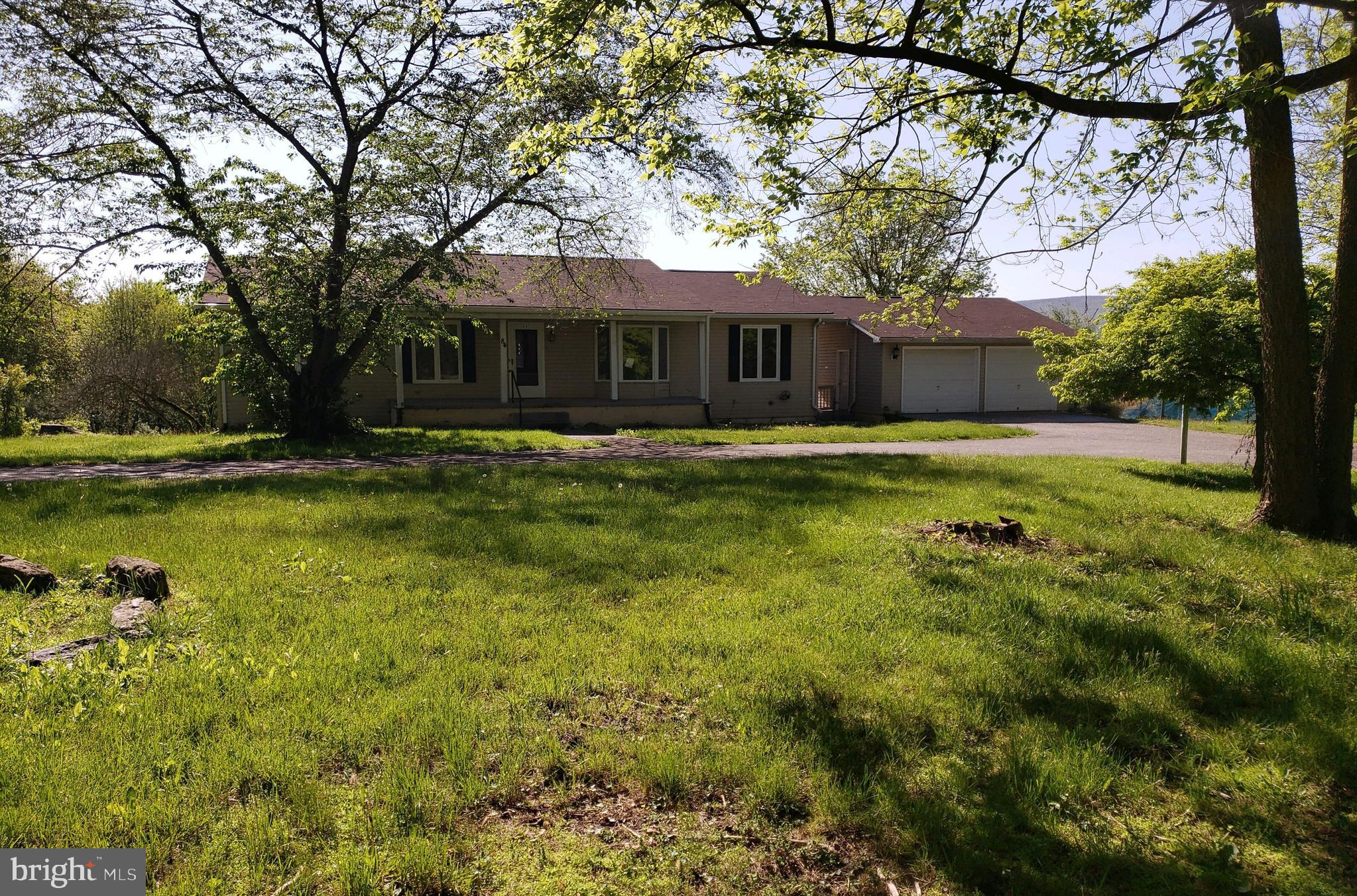 Just off the main road for easy commute, this Ranch style home sits on approx. 1.7+/- Ac lot and fea
