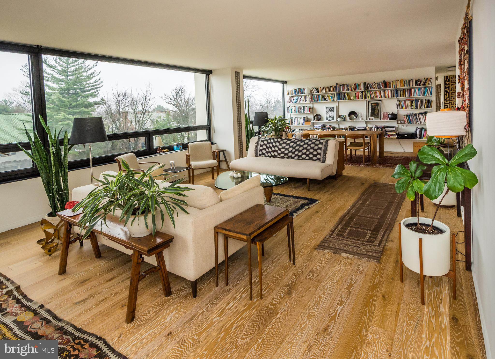 Located in The Highfield House Condominiums, a stunning example of mid-century modernist architecture, this magnificent, 1,505 square-foot corner unit, formerly a 3-bedroom, was renovated to create an airy open space and dramatic, oversized main living area.  The wall-to-wall windows frame the majestic neighborhood of Guilford, giving expansive, panoramic north and easterly views.  Spectacular wood floors throughout.....the bright kitchen was designed to honor the vision of the period, with the sleek, modern appliances of today.  A true masterpiece!  The Highfield House rises over the quiet neighborhood of Tuscany-Canterbury and is designed by a man considered to be one of the pioneers of the form:  Ludwig Mies van der Rohe.   Van der Rohe accepted less than 10 residential commissions in his lifetime, the Highfield being one of them.  It exemplifies the modernist ethos of form-following function, yet its simplicity remains indescribably beautiful. It was added to the National Register of Historic Places in 2007.  24-hour full service building with pool and fitness - gorgeous common spaces.  Condo fee includes central air conditioning, heat, cooking gas, hot water.  Pet-free building.