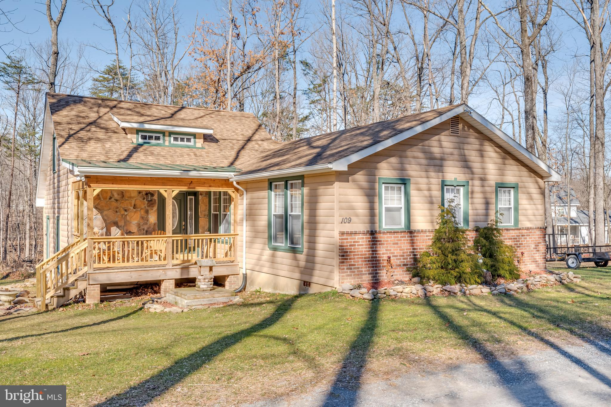 This stunning home sits on over 1 acre of wooded land. The main level features updated flooring. The