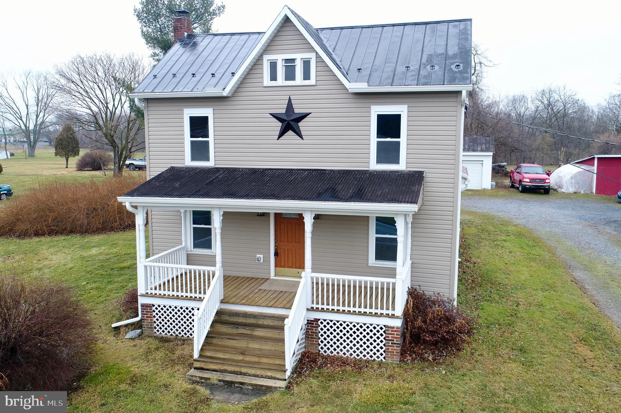 Beautiful FULLY RENOVATED Colonial offering 3 Bedrooms and 2 Full Bath resting on 1 acre of unrestri