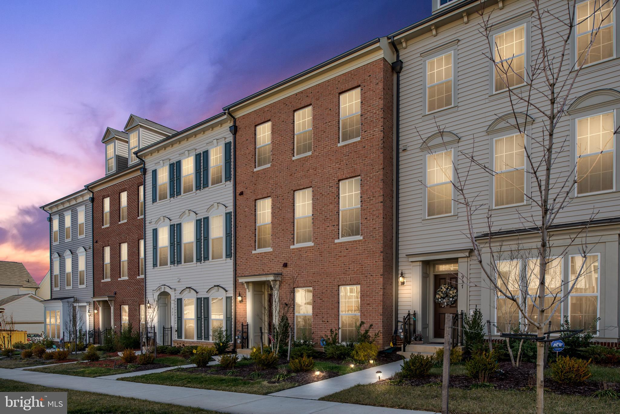 What a gem! You'll love this gorgeous, brick 3-level townhome with tons of custom upgrades in the hi