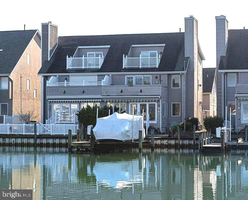 "NEED SPACE?  LUXURY  WATERFRONT  4 bed/4.5 bath townhome, 3,538+-sq. ft., NO CONDO FEES! Dock w/lift, quick access to open deep water.  PARK/WATER VIEWS from each level in this gracious owner-occupied residence.  A private entrance thru gated patio takes you to 1st floor living rm w/fireplace, dining, spacious kitchen w/island, breakfast area, built-in desk, powder rm.  Hardwood floors thru'out 1st.  Gourmet kitchen includes JennAir down/draft range, double wall ovens, Corian counters, pantry.  Convenient access from 2-car garage to laundry and 2nd of two staircases (back one has chair lift!)  Enjoy the  all-season waterfront sunroom w/sliders to deck w/retractable awning, dock w/lift,  park view!  The front  ""split"" staircase to upper landing opens to amazing space - now a great room/study - or the bonus 4th bedrm/bath option!  This his floor also includes 2 master bedrm suites with 2 full baths, a 2nd full kitchen, waterfront balcony, back staircase to 1st floor w/removable chair lift.  Bonus third floor features private bedroom/sitting area, full bath and another waterfront  balcony!  Multiple zone HVAC's (3),  including 2 ""Apollo""/hot water combo units,  central vac, Pella windows,  intercom!  This home is perfect just for you and with room for more !"