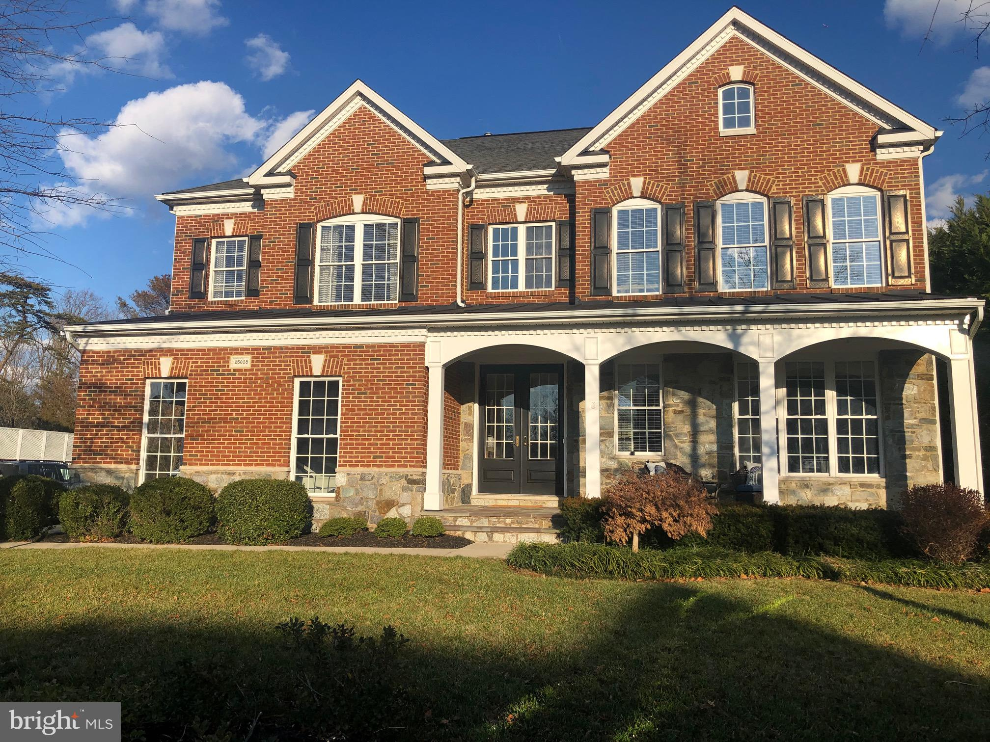 Stunning South Village home backing to nature preserve, trails and golf course on low maintenance lo