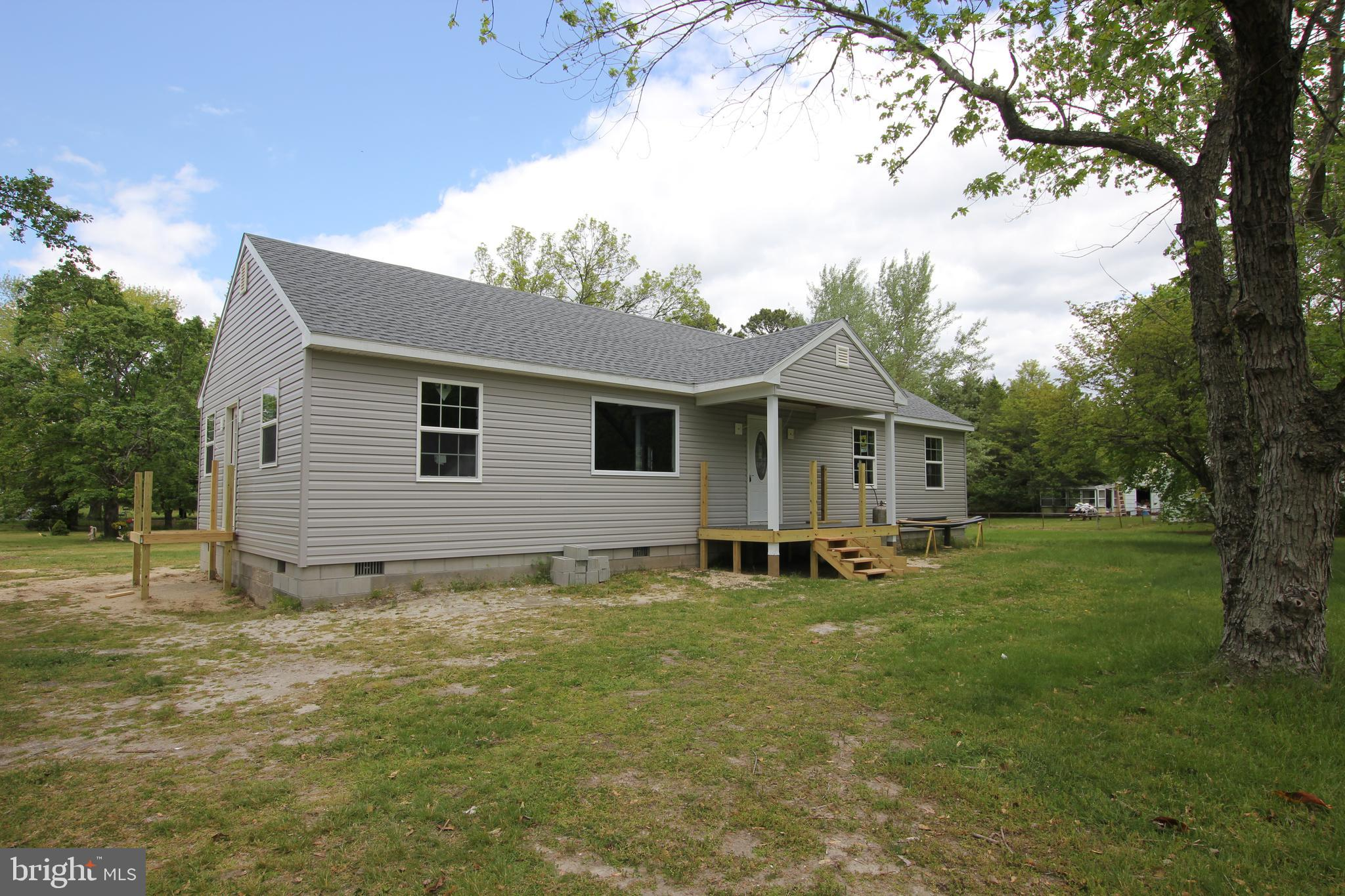 Brand new construction home located on a spacious corner lot. One-level rancher style home with thre