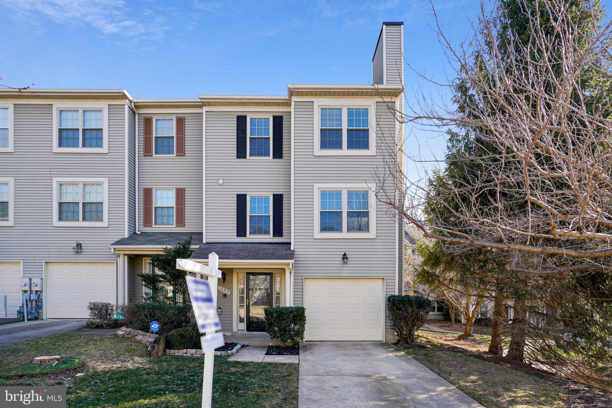 Welcome to this spacious and bright,  3 level,  garaged end unit townhome.  The main level offers a