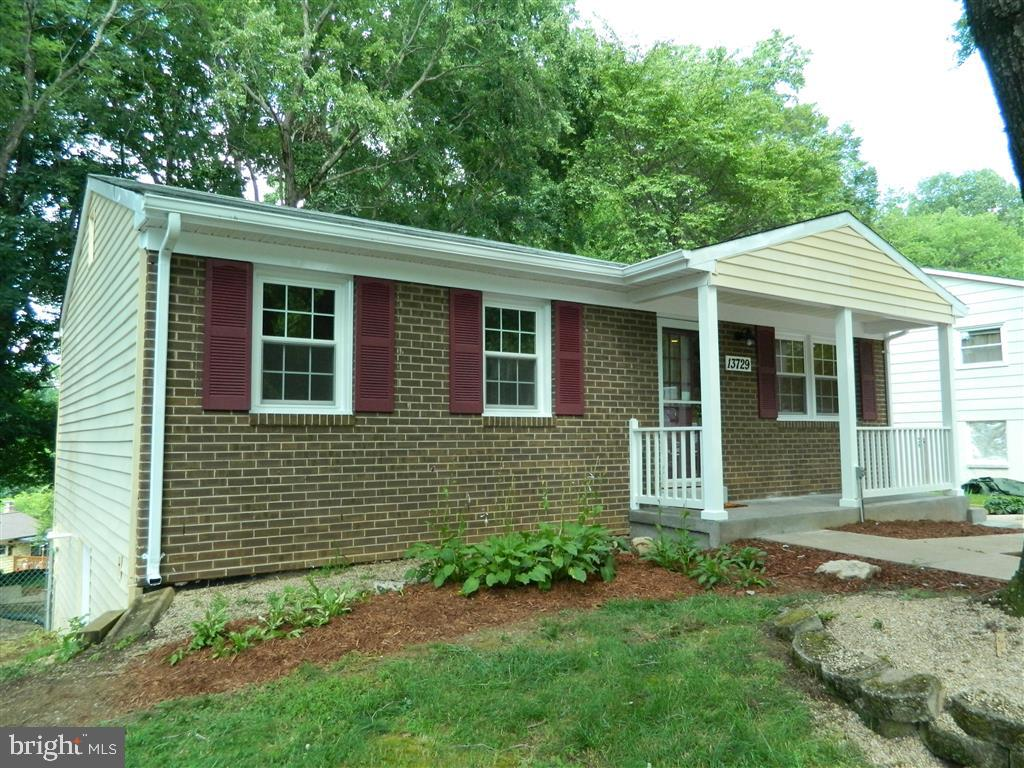 Completely & beautifully renovated SFH in Dale City with 4 beds, 2 baths, large new deck and enclose