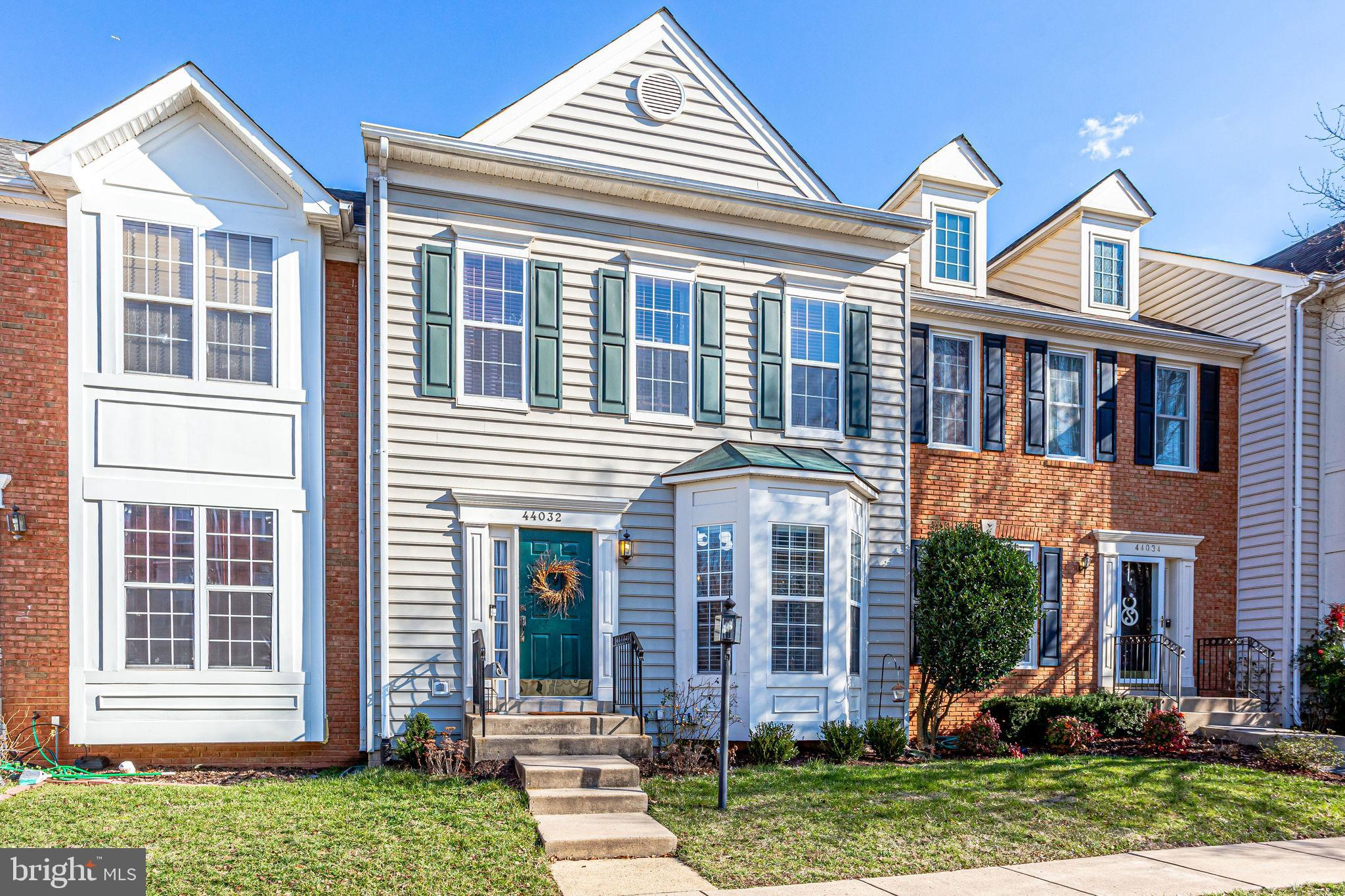 Stunningly beautiful Ashburn Village townhome situated on the lake! Breathtaking views! Sit on your