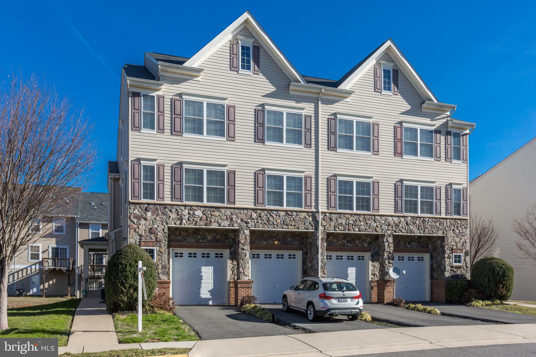 PHOTOS COMING SOON! End unit townhome filled with tasteful upgrades.  Walkable to shopping, dining,
