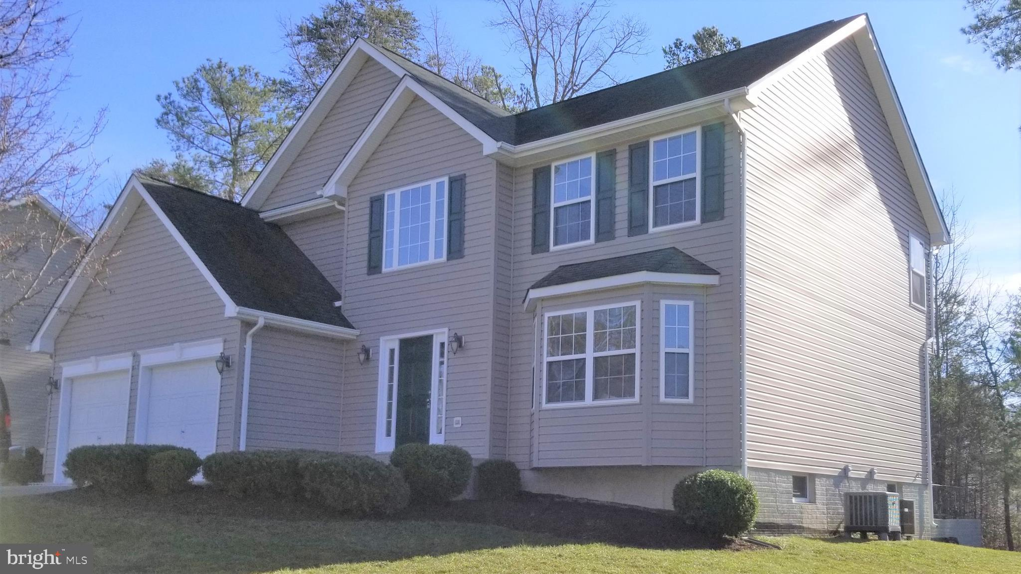 Looks like a New Home! Freshly painted ! this 4 bedroom 2.5 bath home in lovely area of Willow Woods
