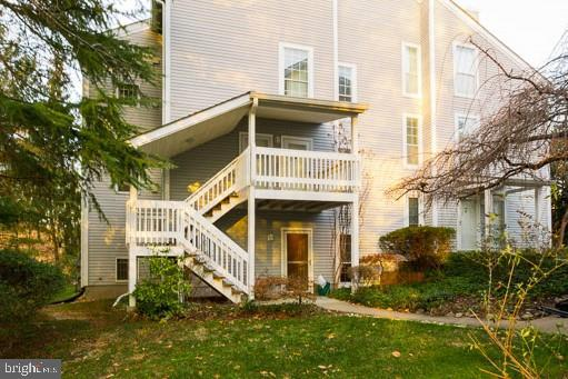 Freshly painted and cleaned 2 BR 1 BA ground-level corner-unit condo offers 1,242 finished square fe