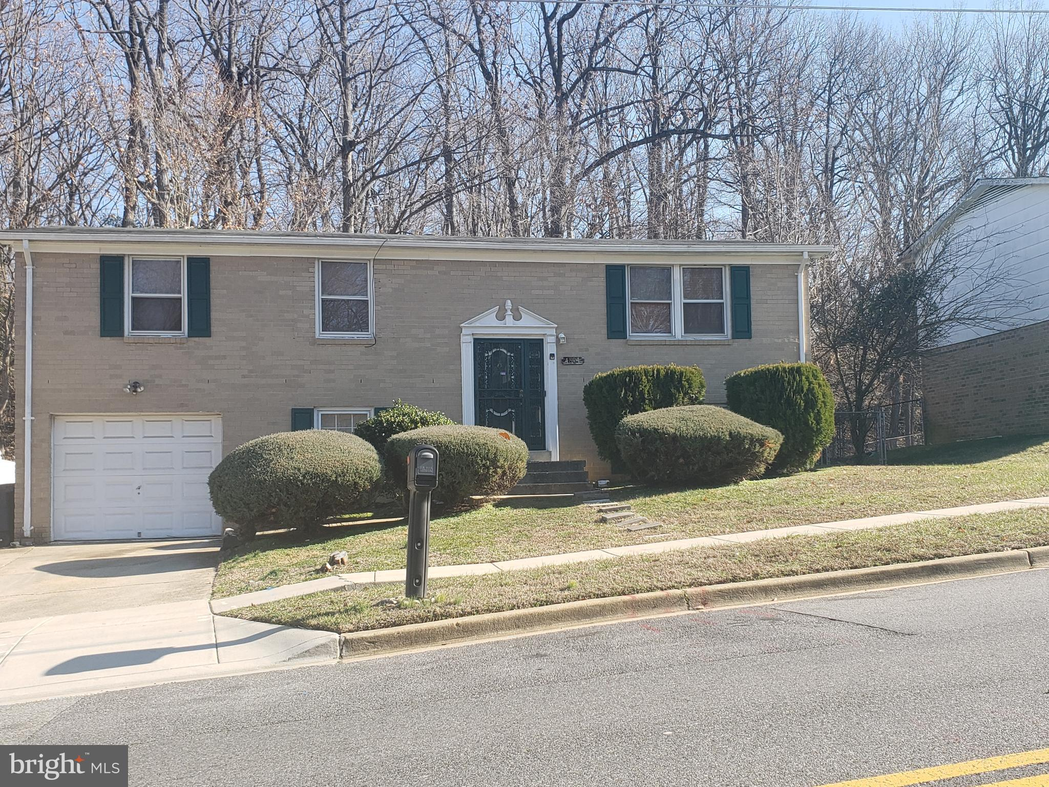 You  will love this very well maintained, spacious single family house.  It boasts 5 generous sized