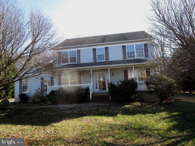 Three-level colonial on Cul de Sac Inground Pool with Cabana and rear yard backs to trees for privac