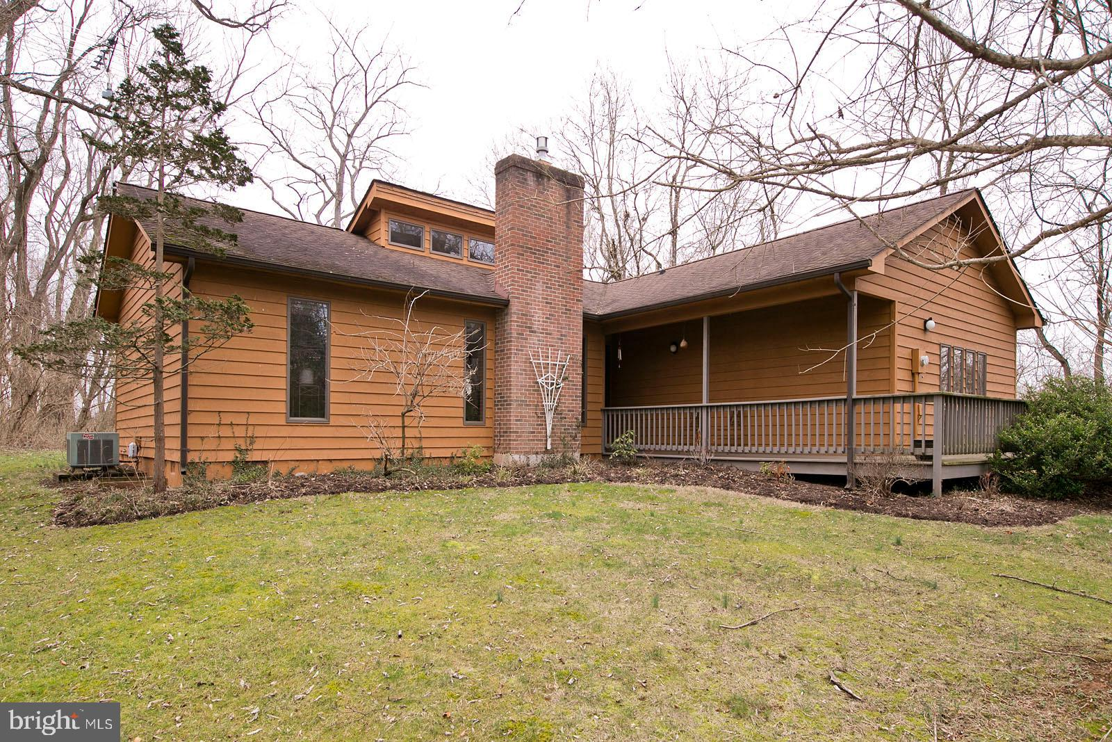 One level living in a private setting.  This 3 Bed/2 Bath rancher is perfect for retirees  or commut