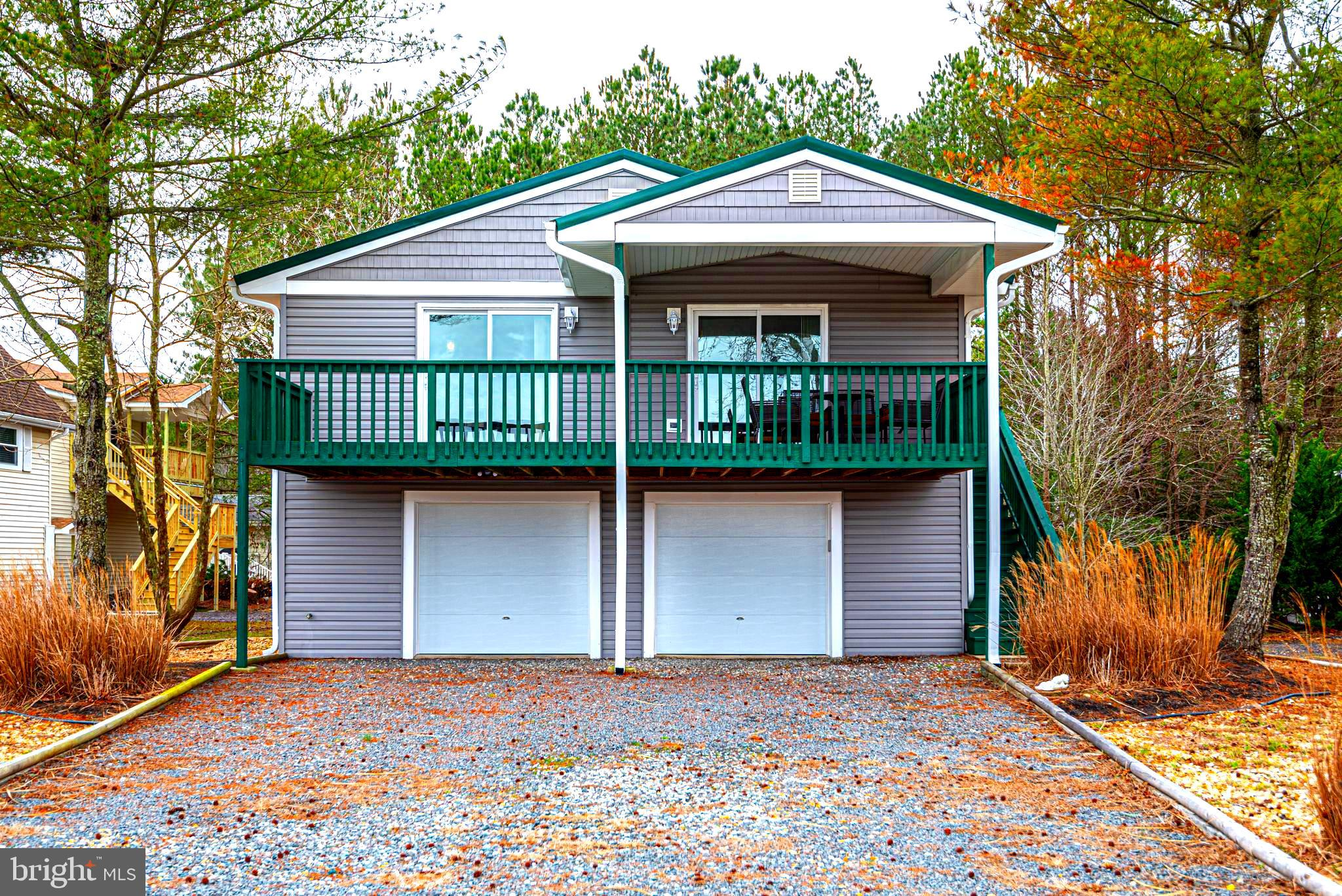 """""""JUST REDUCED $15K"""" Beautiful raised rancher has been totally renovated in 2019 with canal water views over looking Pintail Park from the second floor balcony. This gorgeous home features new vinyl laminate & travertine tile floors, granite counters, island bar w/seating, new cabinets, electric FP w/Real Stone, vaulted ceiling, MBA w/breath taking marble tile flooring & walls, 10 jet Jacuzzi tub, new metal roof, new vinyl siding, new windows & sliding doors, new gutters(helmet guard) & down spouts, new windows & sliding glass doors, Heat Pump(2018), new landscaping & under home garage that could fit up to 4 cars. New bonus room on the first floor could be Man/She cave or exercise room. Furnishings are negotiable. Minutes from the beach in Ocean City. Make this your next stop in Ocean Pines."""