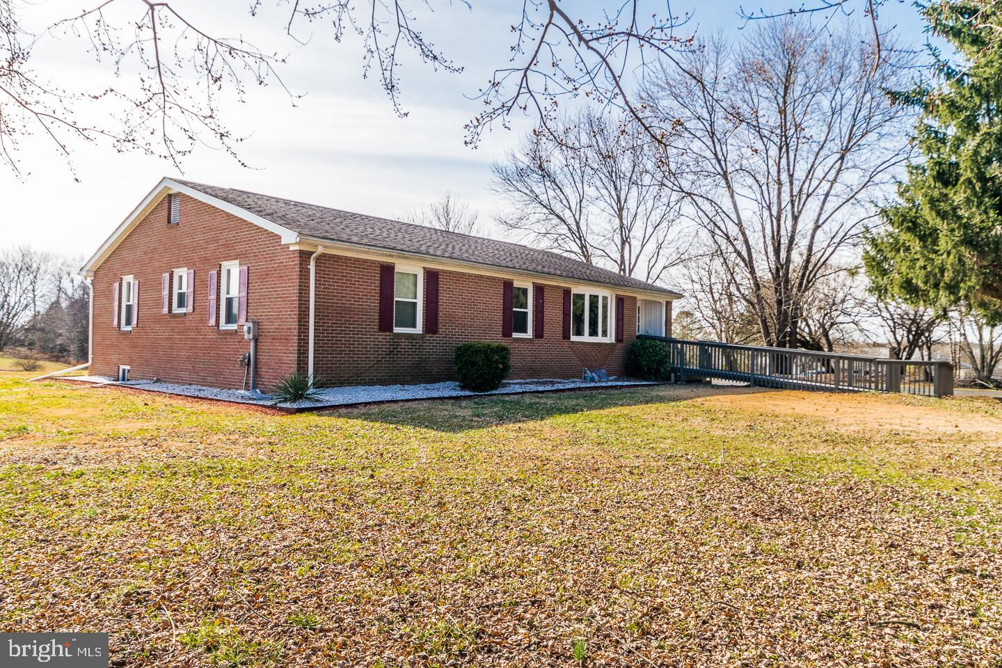 Big Reduction!!! Looking for the location and space to roam. This over-sized all brick rancher has 3
