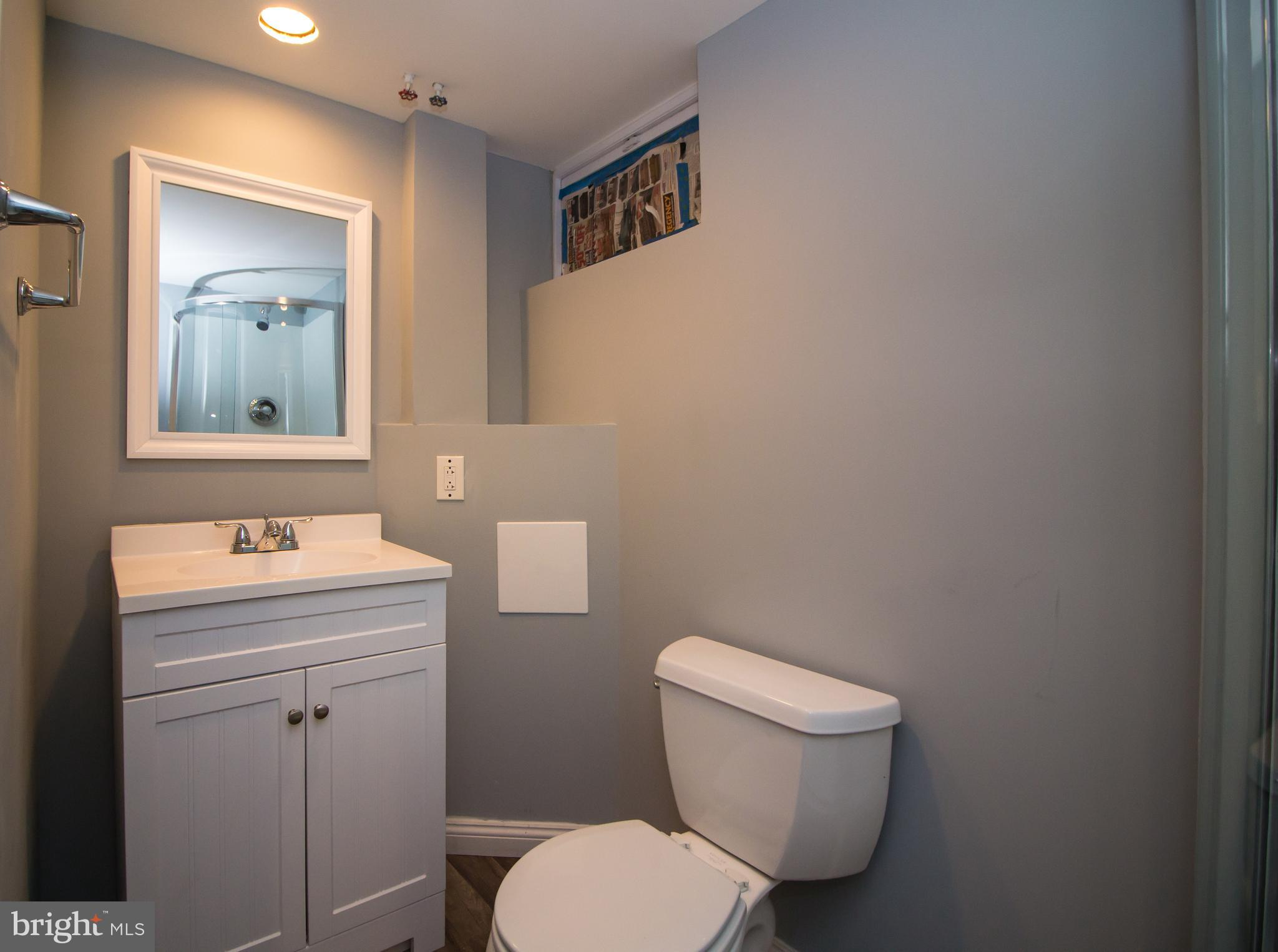 You must see this renovated  4 bedroom, 2 full bath townhouse near Morgan State University.  Step in
