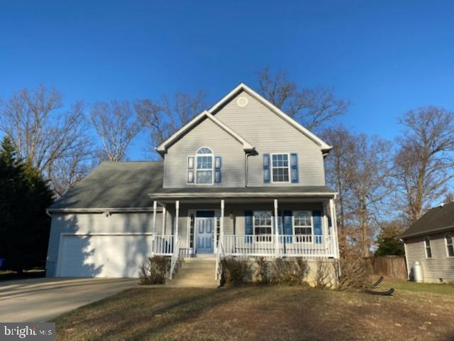 Fully renovated Colonial with 4 bedrooms, 2 full baths, fireplace, full unfinished basement and rear