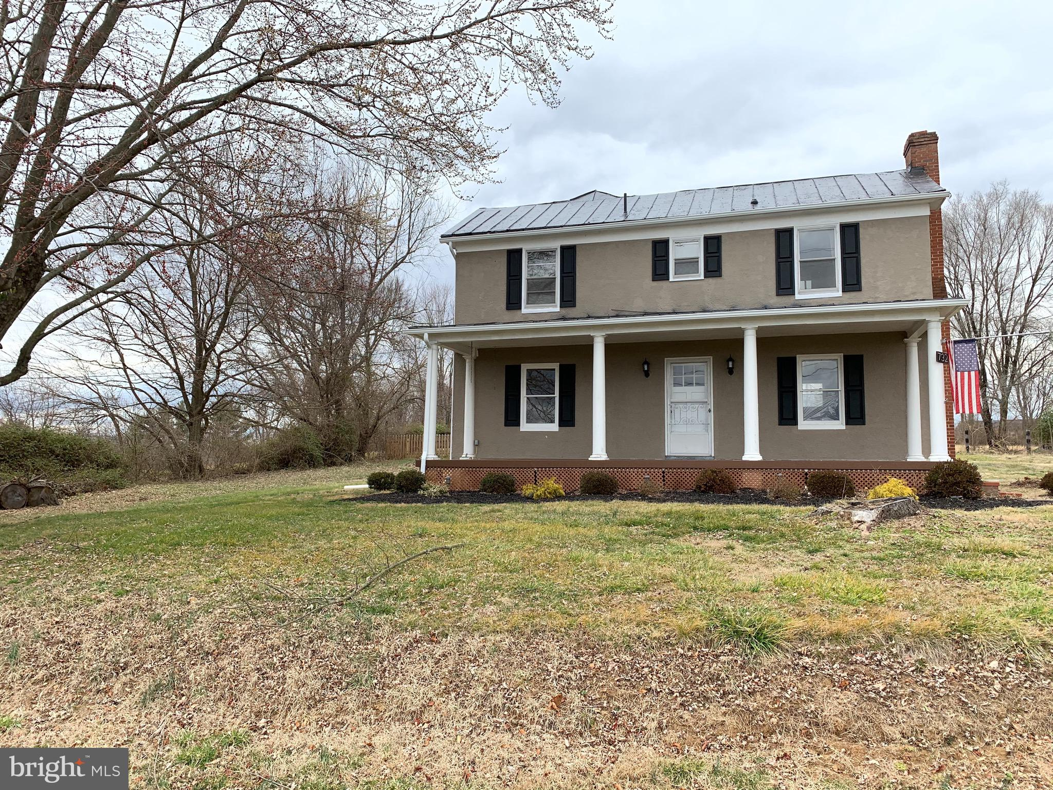 Beautiful house in Berryville including a big front porch with mountian views, large lot in town, th