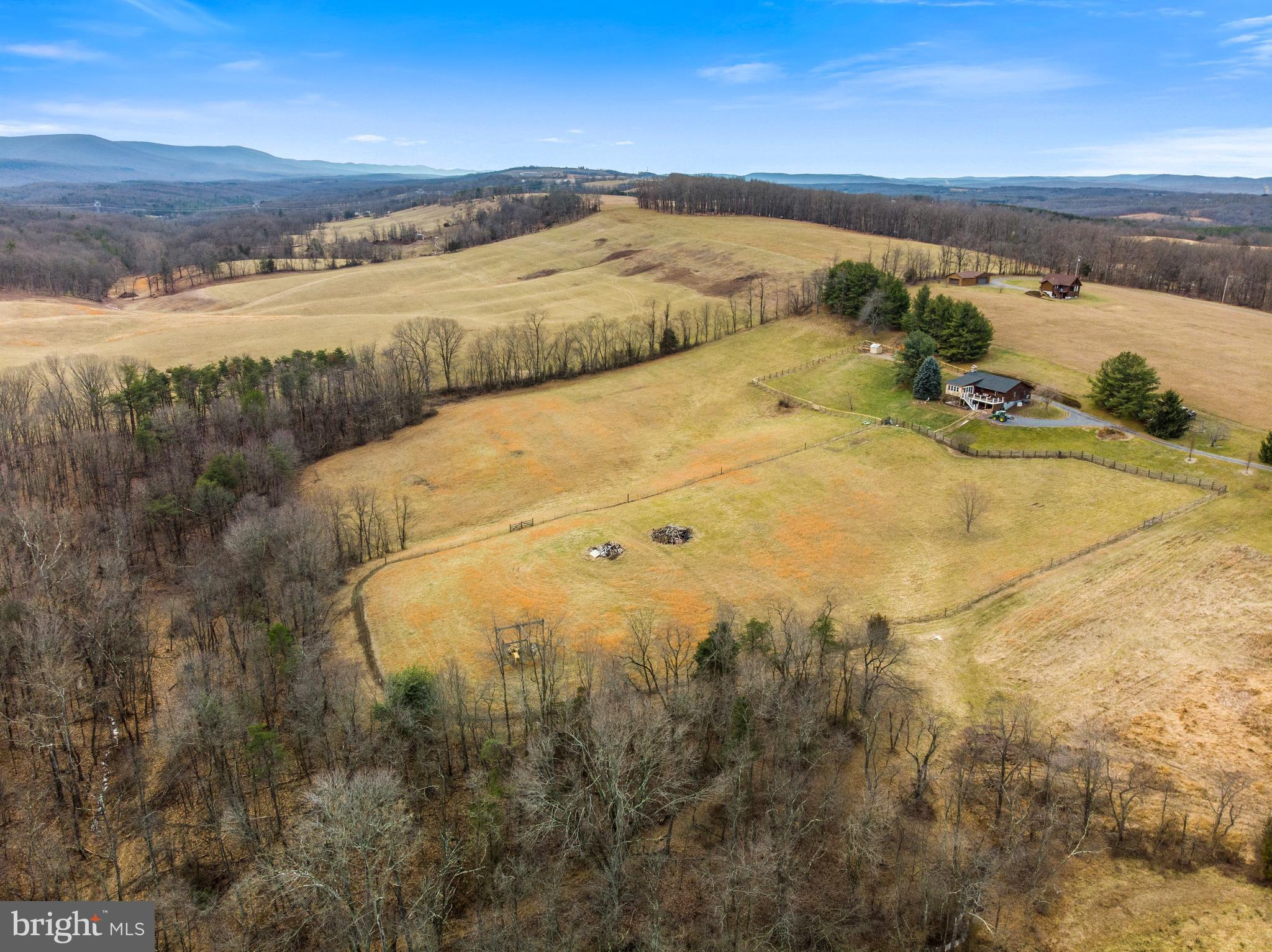 Nestled on almost 26 acres you'll find this 3 BR 3 BA Rancher on a Full unfinished Walk-Out Basement offering Gleaming Newly Refinished Hardwood Floors, Remodeled Bathroom, New Roof in 2018, New Sun Room Addition, New Front & Back Azek Decking, New Hot Water Heater, New Whole House Generator w/500 gallon tank, New Carpeting in 2018, New HVAC Unit, Approx 2 acres of New Fencing, Ready to go Chicken Coop, UV light for well, great Internet Access thru Winchester Wireless, Partially fenced area for livestock and New Tin Ceiling under Deck to stay dry.   This property is approx 15 from Winchester, 8 min to Capon Bridge.  Sellers are offering $5,000 credit towards painting outside with reasonable offer.PROPERTY IS LISTED BELOW NEW APPRAISED VALUE RECEIVED ON 1-31-20
