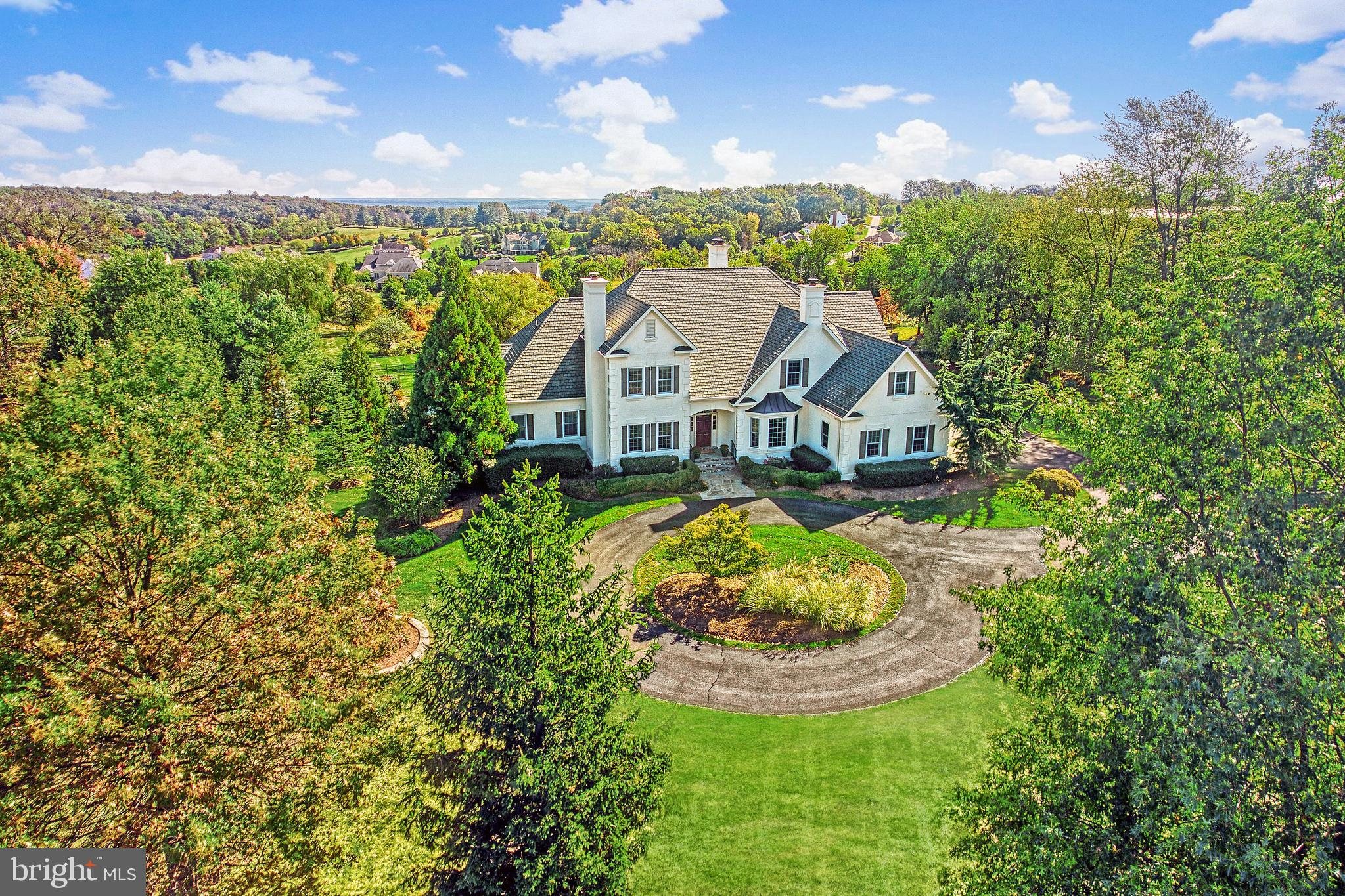 Perfectly sited on 3.16 manicured acres in Beacon Hill, this beautiful custom home offers both priva