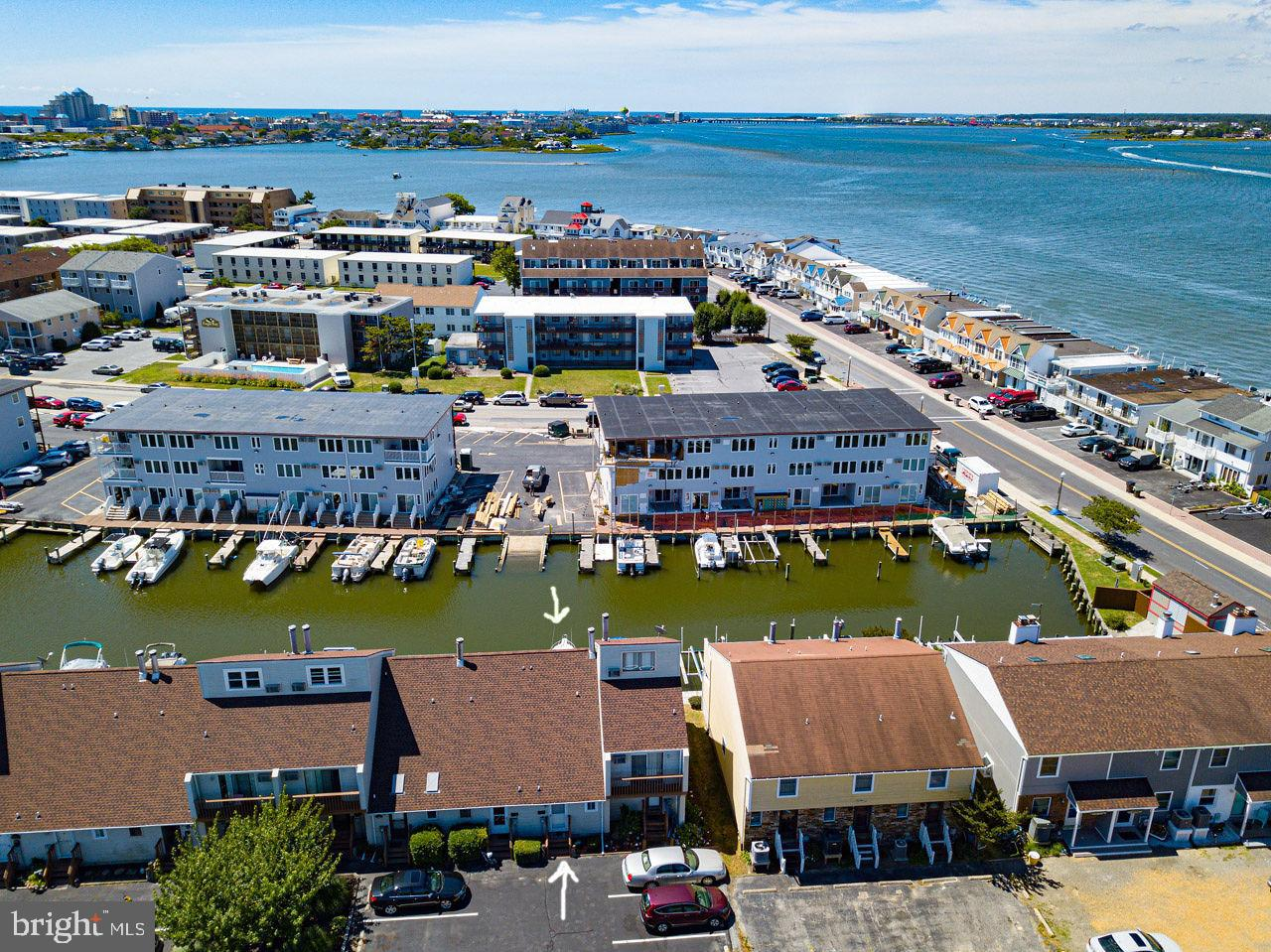 A SUPER BUY WITH SLIP!!     SUPER CUTE UPDATED WATERFRONT w/ its own  boat slip... Turn Key & Fully Furnished!  Great Location on Cul-de-sac  On a Quiet Road no through Traffic.  Perfect Water Access to all the good spots in town... 1 BR/1.5 BA  Completely  rehabbed  in 2014/2015.  New Flooring - New Custom Kitchen , Bathrooms Updated. New Sliding Doors &  Window. Wood Burning FP, New Interior 6 Panel Doors - New Deck & Balcony - New Remote Control Awning w/LED Lights, Wind Sensor & Roll Up Privacy Shade... Extra Bed in a Separate Loft Area and newer Sleep Sofa in Living Room.(can actually sleep 6 people)  Everything Updated in entire townhouse &  In  Great Condition. Only an small 10 unit building!  Plus New Roof - New Boardwalk - THIS IS THE PLACE FOR YOU!  BONUS...  SUPER LOW CONDO FEES!!All you need to do is bring your summer gear & your boat!  Close to many restaurants, boardwalk, beach and amusement park! If you buy now, be ready for lots of summer fun!