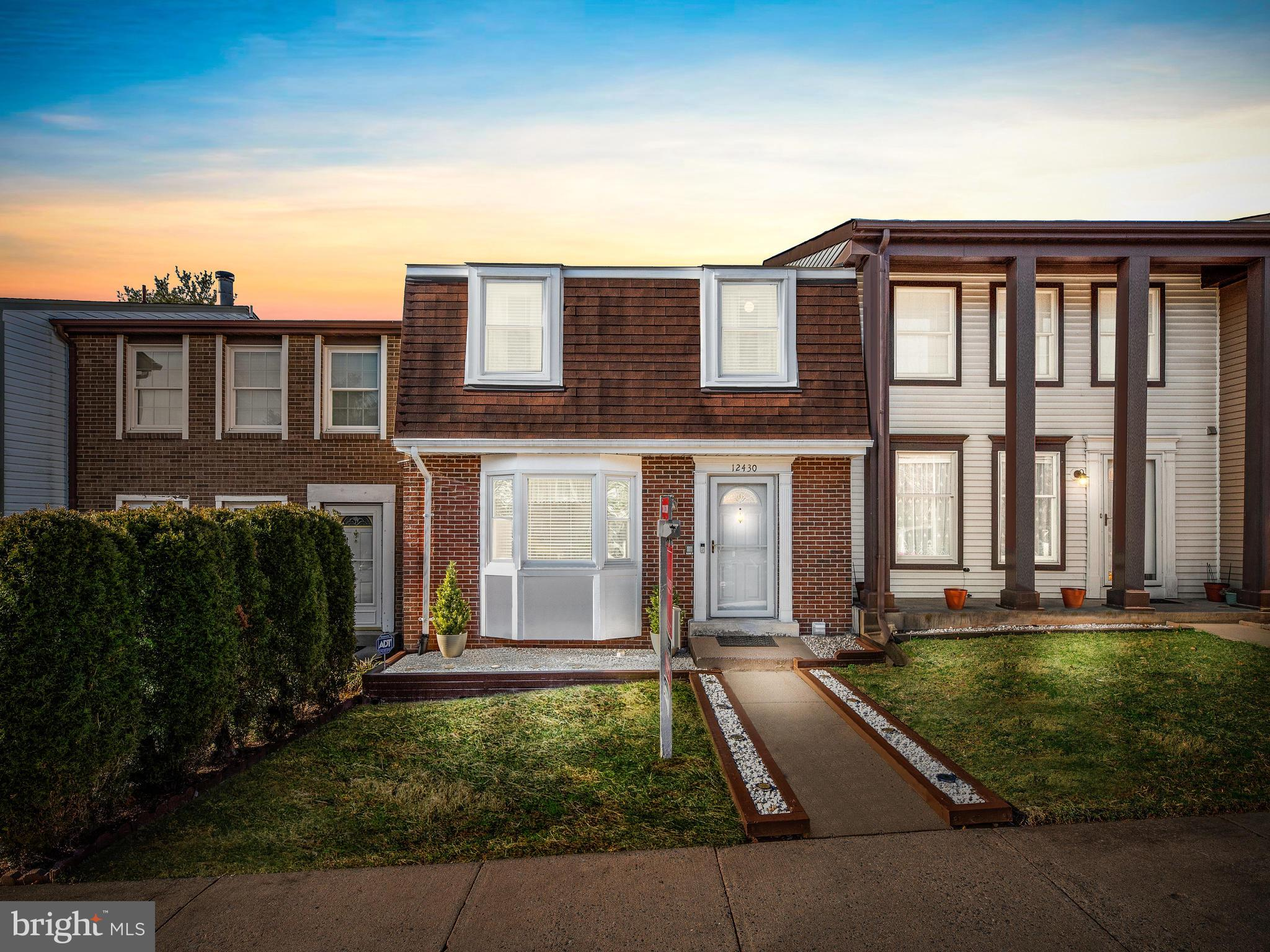 Rare Gem in Pristine Condition! Stunning brick front townhome offering 3 bedrooms, 2 full and 2 half