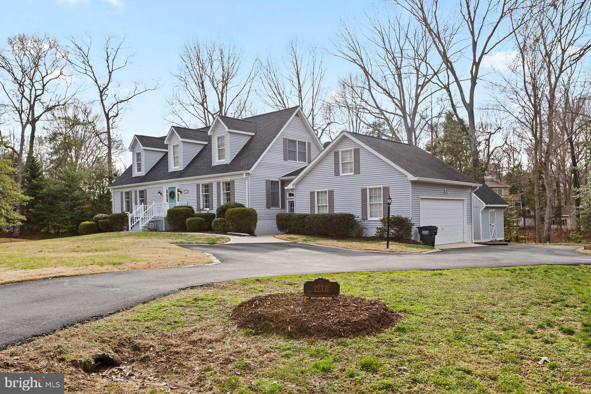 Come home to an absolutely beautiful Cape Cod in popular Breton Bay on a private lot! You'll fall in