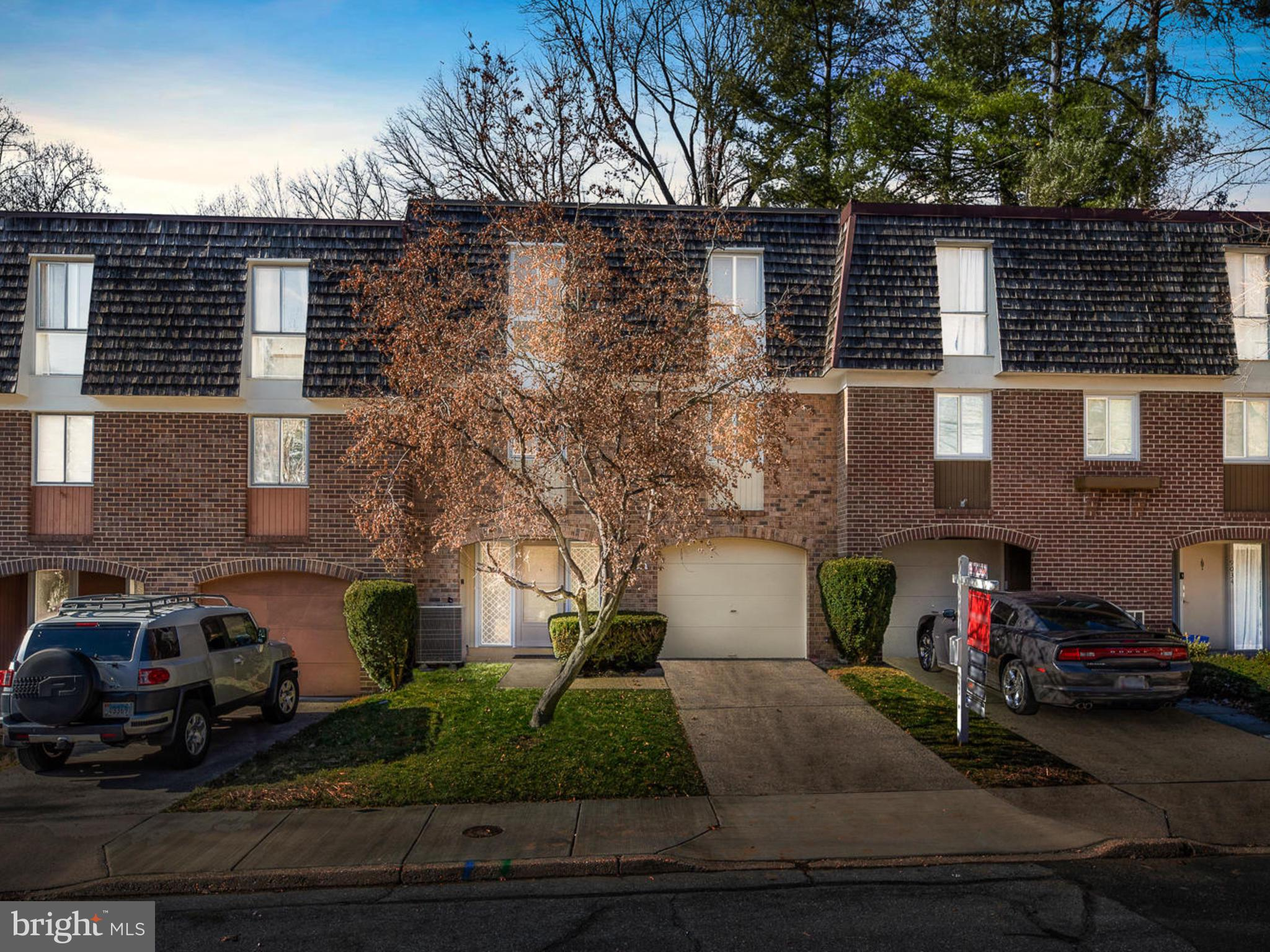 Exquisitely charming & like-new! 3 bedroom 2.5 bath townhome filled with natural light, with neutral