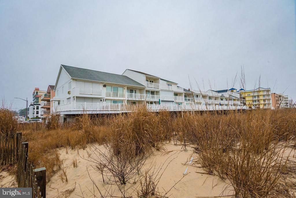 If your ready to begin making beautiful family memories at the Beach then this is the Property For You.  This home is fee simple  -  NO CONDO FEES - NO HOA FEES - Step off your sunny deck right onto the sand.  This property features 4 Bedroom and 3 1/2 Updated Bathrooms.  Laundry Room with Washer and Dryer on the bottom floor.  a beautiful kitchen and family room with amazing views of the ocean from family room and master bedroom.  Potential Rental Income of $55k +.  This property is being sold AS IS.