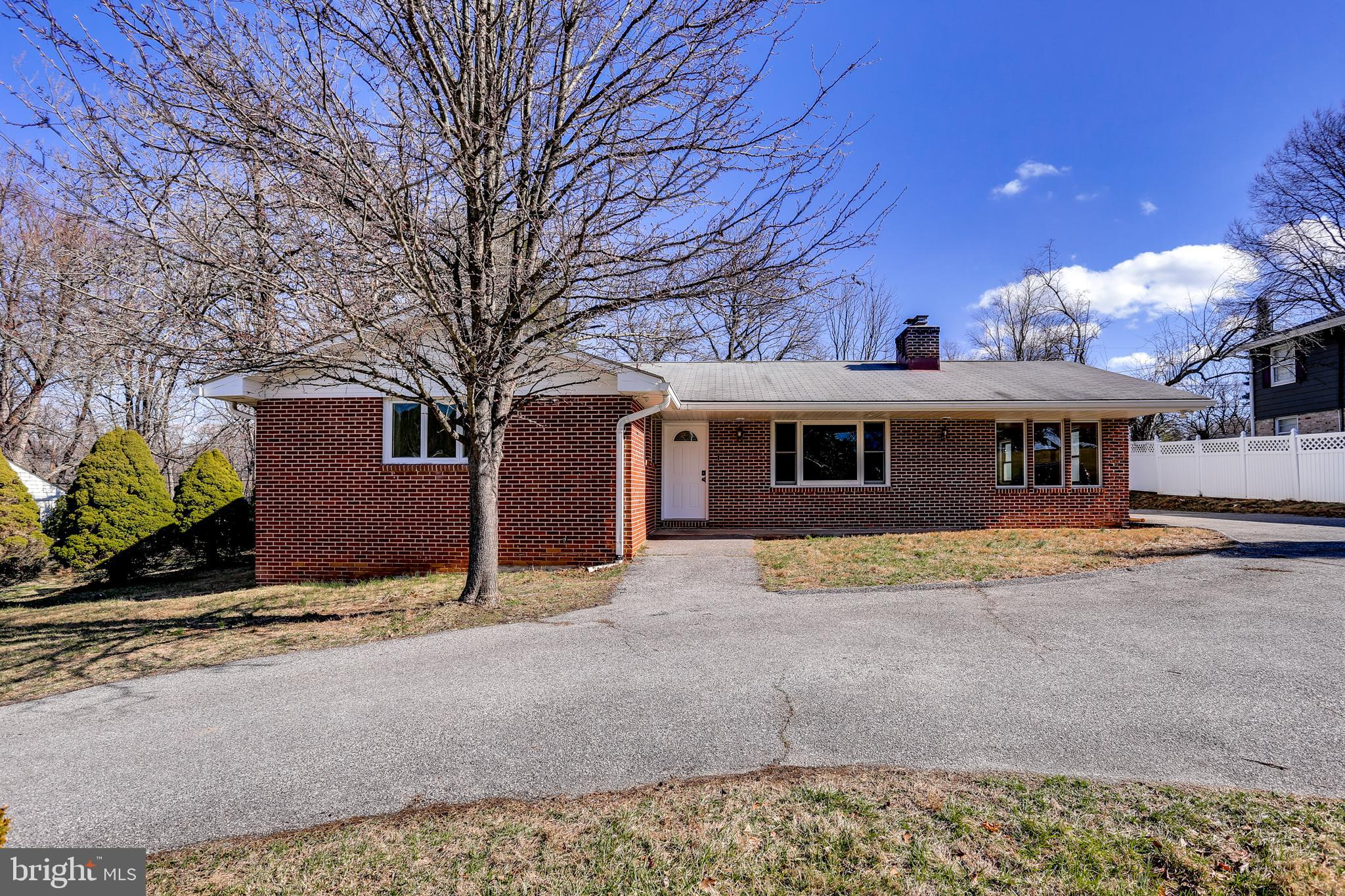Fully Renovated and Move-In Ready! Come see this gorgeous brick front rancher on nearly half an acre