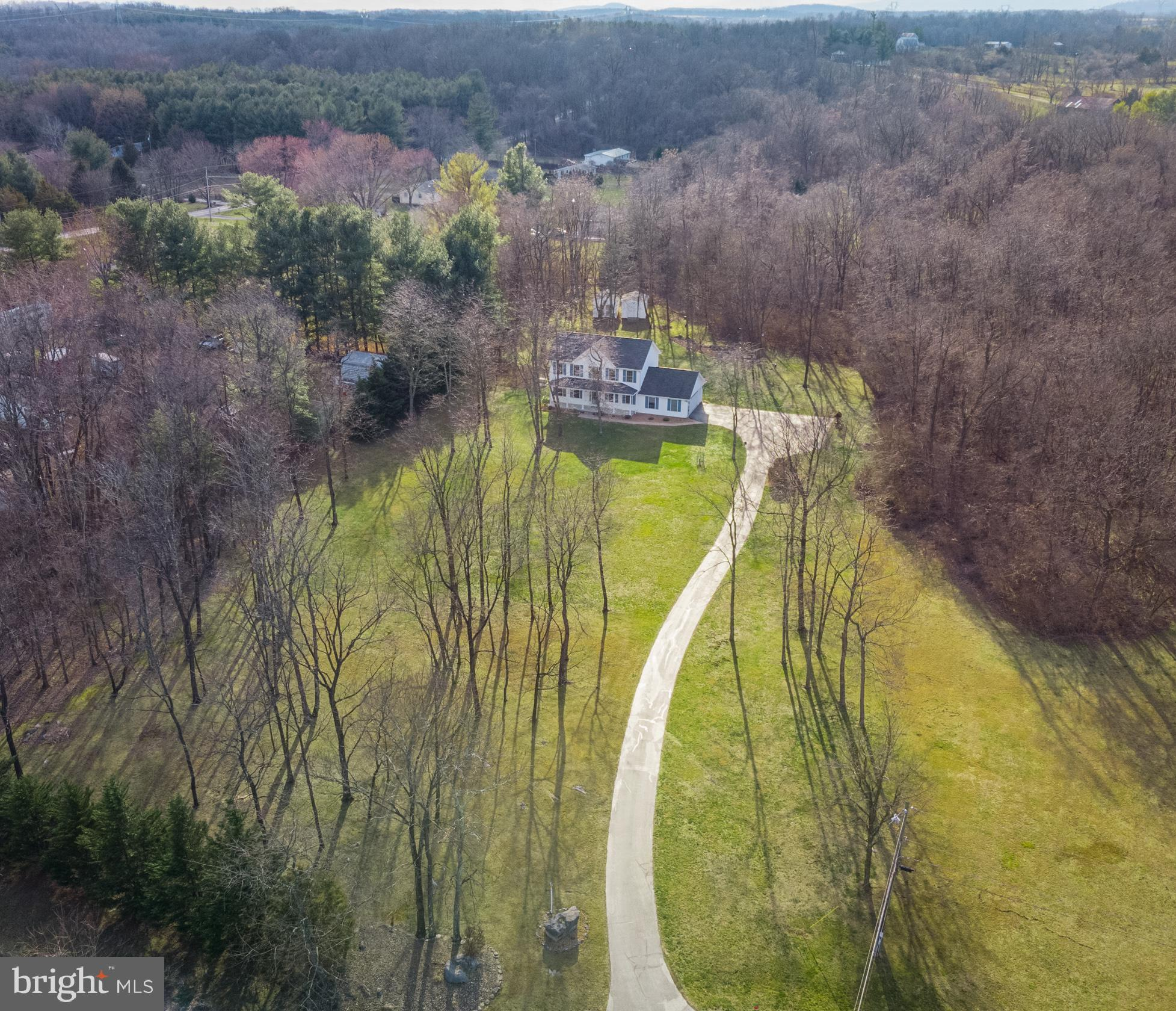 Want to live on acreage while still living in neighborhood? Here's your chance to have the best of b