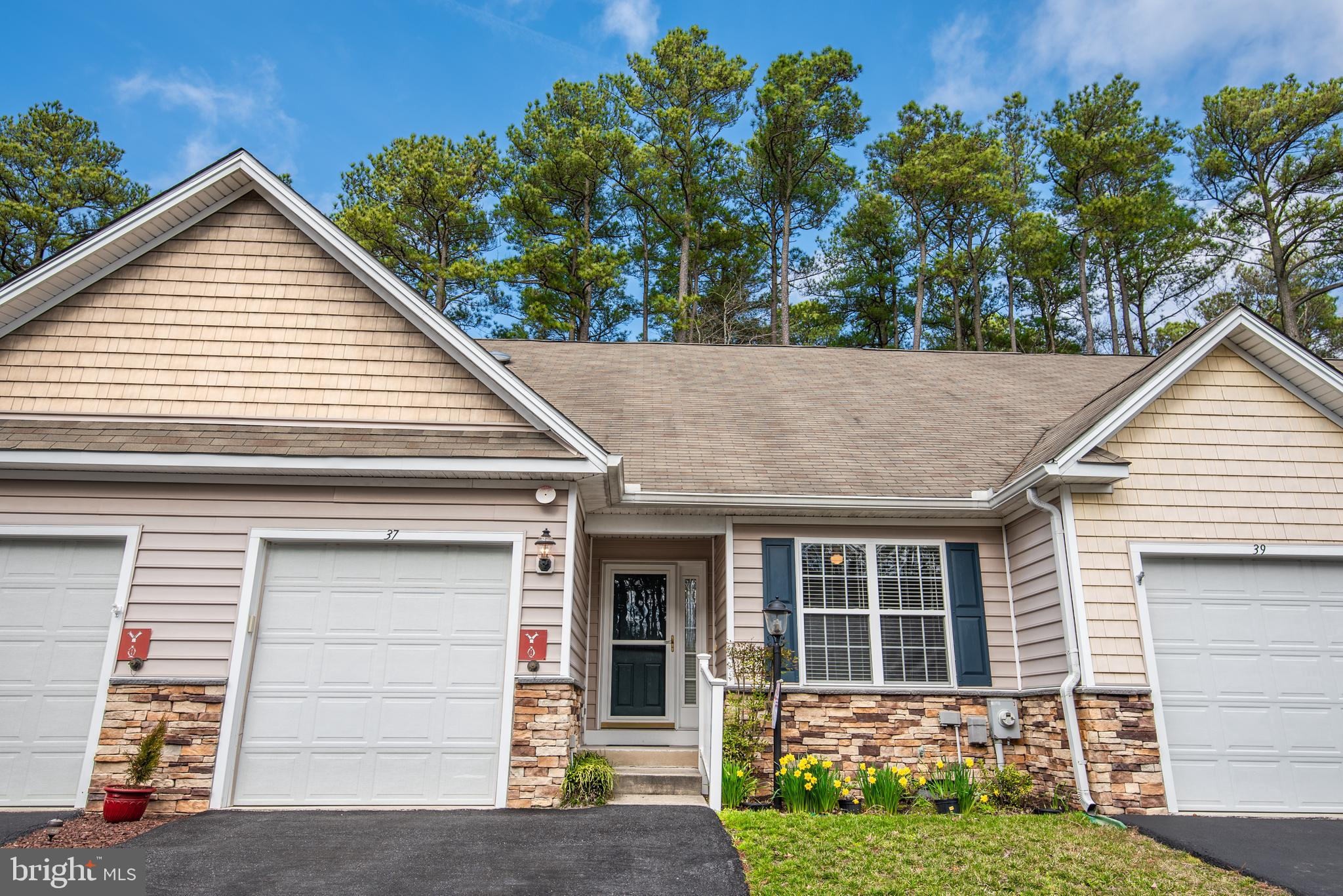 Extraordinary gem of a home in the Premier Plus 55 Community of the Parke of Ocean Pines. This lovely one level 2 bedroom, 2 bath , sunroom plus one car garage home is available for immediate enjoyment. Home showcases Newer carpet and padding 2017, Newer hot water heater July 2018, Converted to Natural Gas in 2018, Stainless Steel Refrigerator, Washer, Dryer replaced in 2015. Exceptional features to the home include upgraded cabinetry with pull outs, Sky Tunnel in Kitchen; Designer ceiling fans with light fixtures faux wooden blinds though out, custom valances, laundry room shelving and home was recently freshly painted! Entertain friends and family on the expansive brick patio backing to forest retention area leaving plenty of room for a barbeque or a crab feast. No worries for storage with large one car garage complete with shelving! So why wait to enjoy the beach lifestyle now is the time to buy. Call for your private showing today!