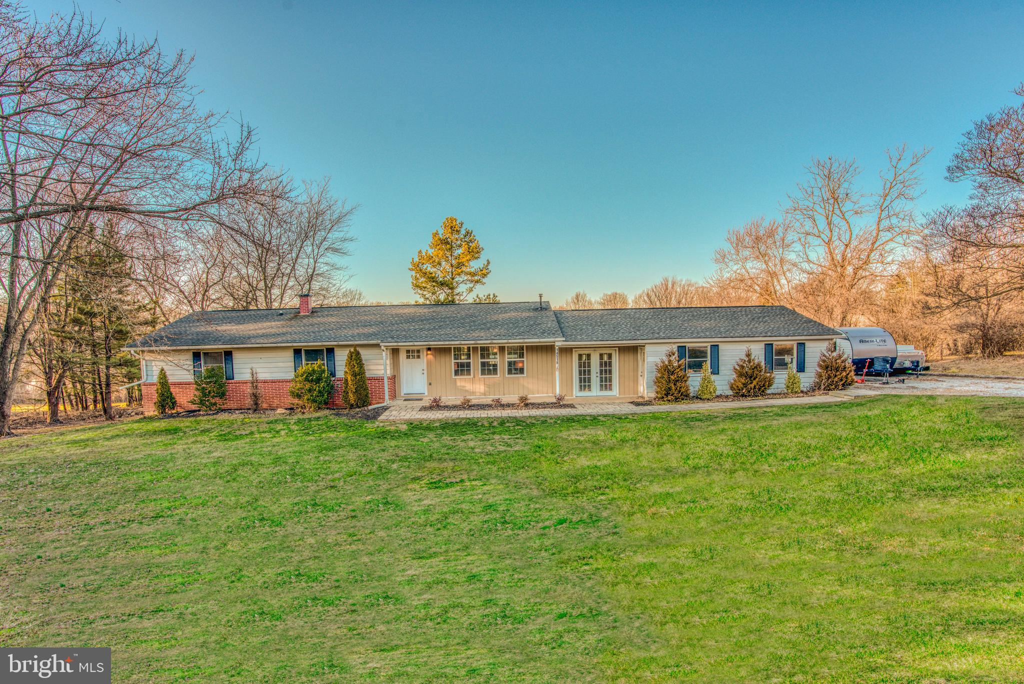 Beautifully Updated Large 4 Bedroom Rancher sitting on 1 Acre of land. Located just North of four co