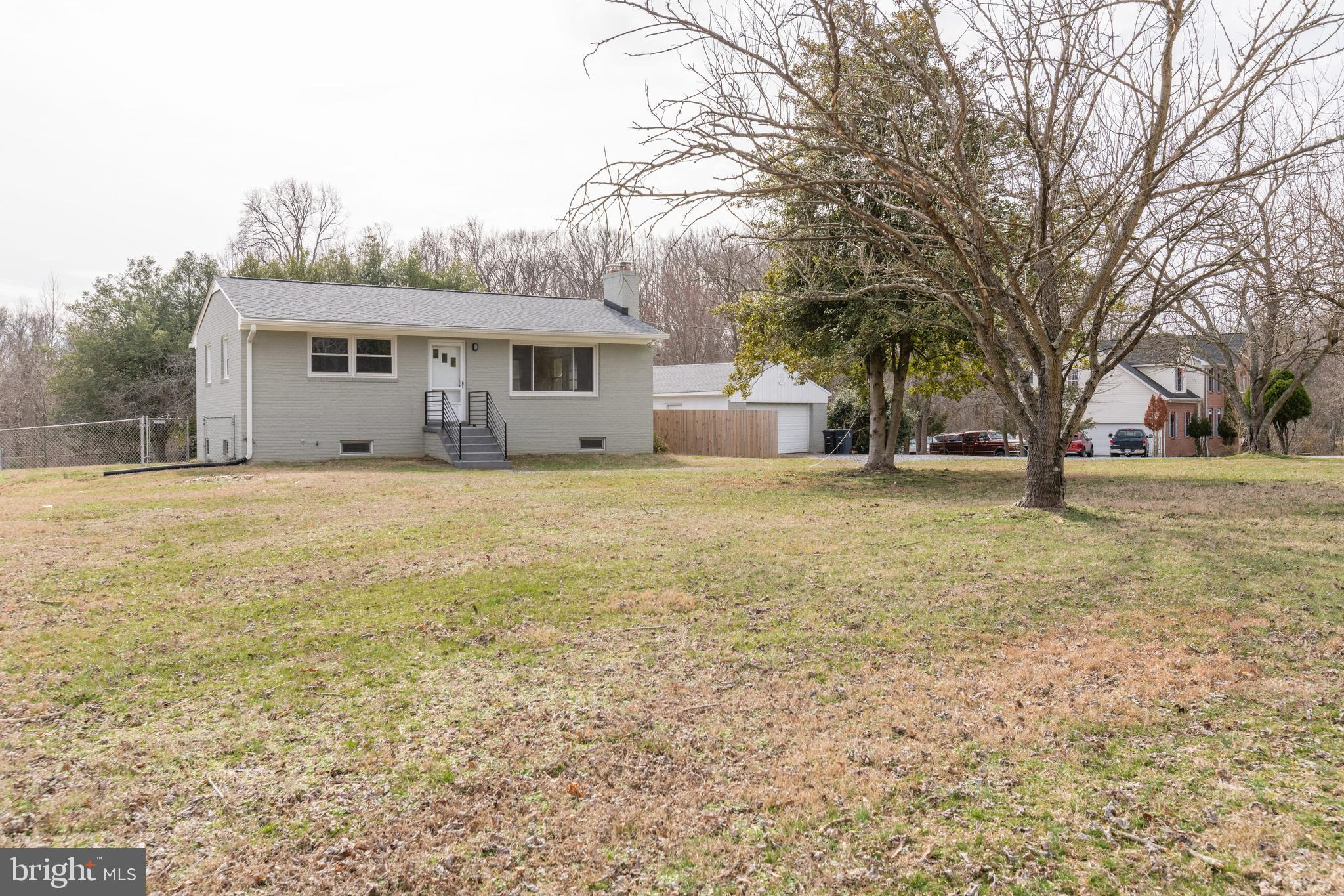 Updated home on gorgeous five acre lot. Polished hardwoods throughout main level. Renovated kitchen