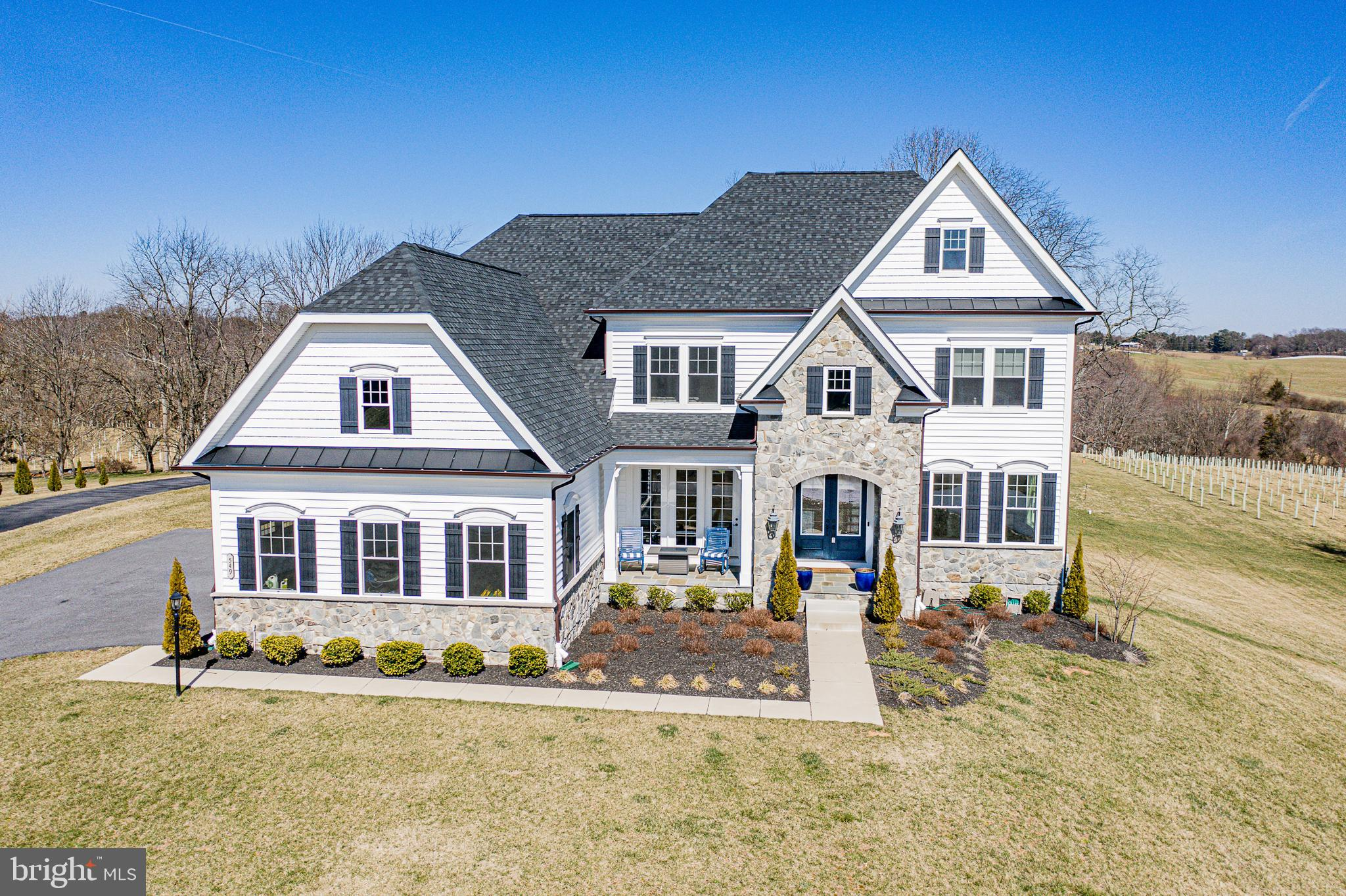 An absolute dream home! Rare opportunity to own in gorgeous Pooldale Farms! A two-story foyer greets