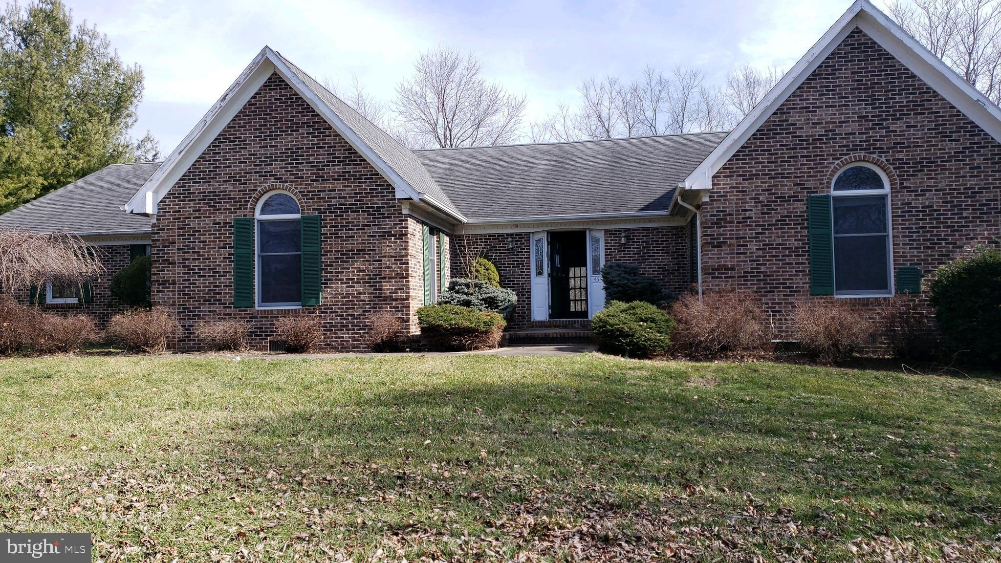 Brick Rancher featuring full basement large rec room with bar,   separate dining and living rooms, f