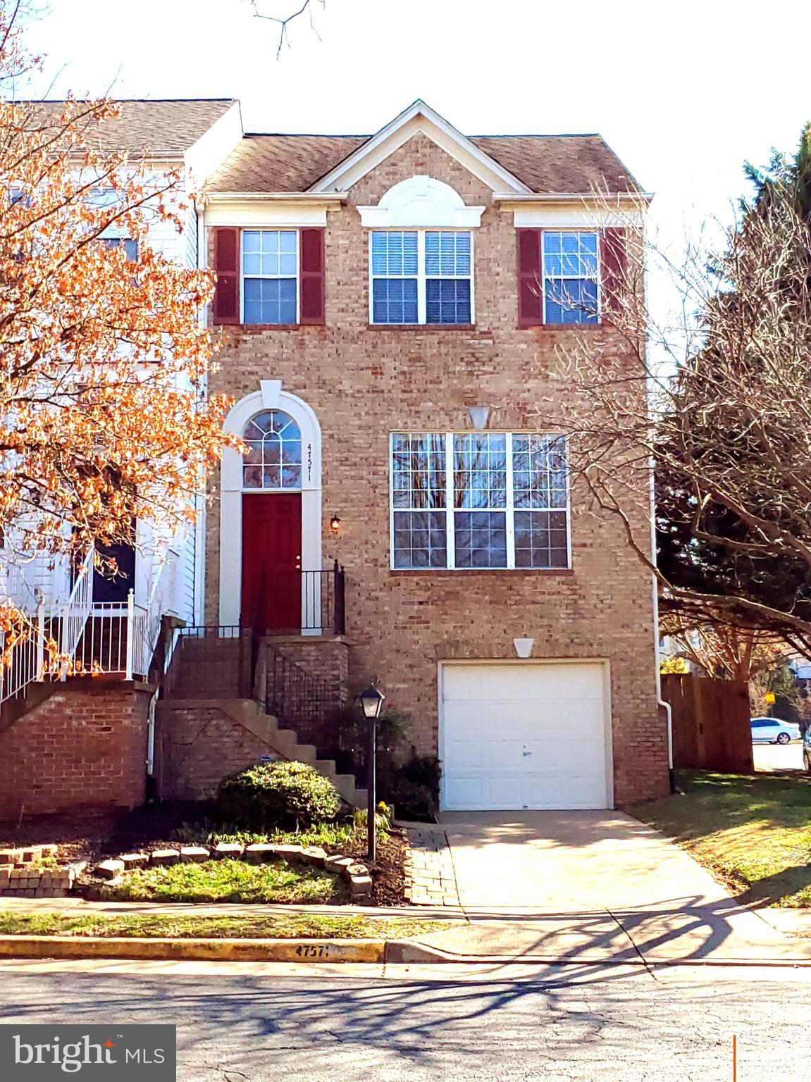 Beautiful Brick Front End Unit Garage Townhome with 3 Bedrooms, 2 Full, 2 Half Baths in Popular Lowe