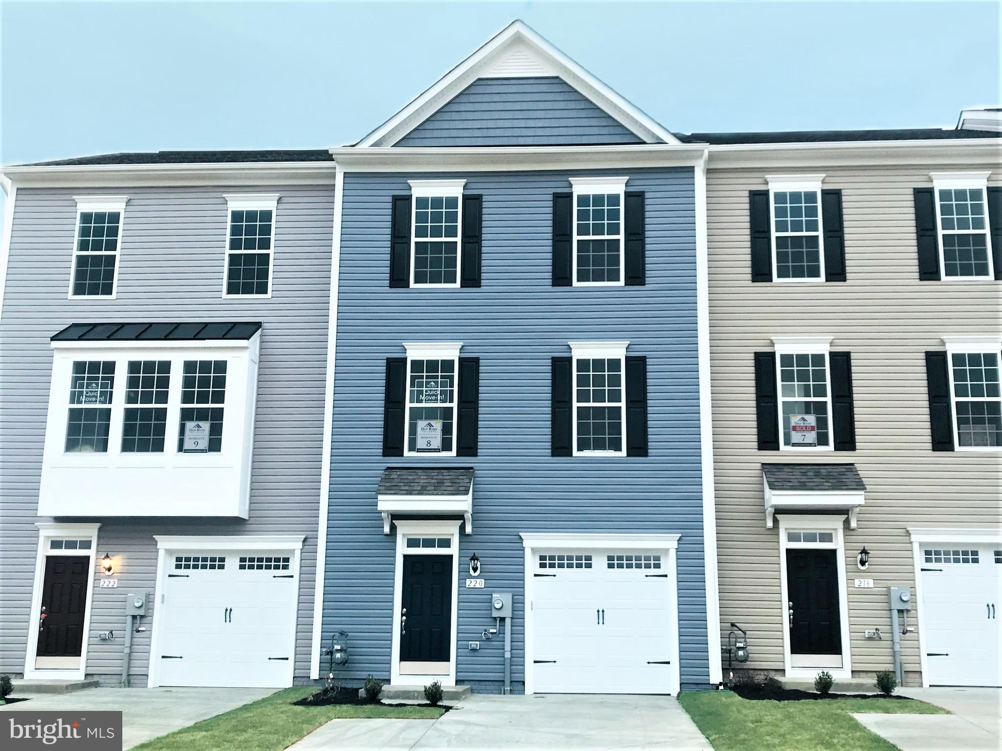 Desirable End Unit Luxury Garage Townhome w/ spacious rear yard in sought after Walkersville! This b