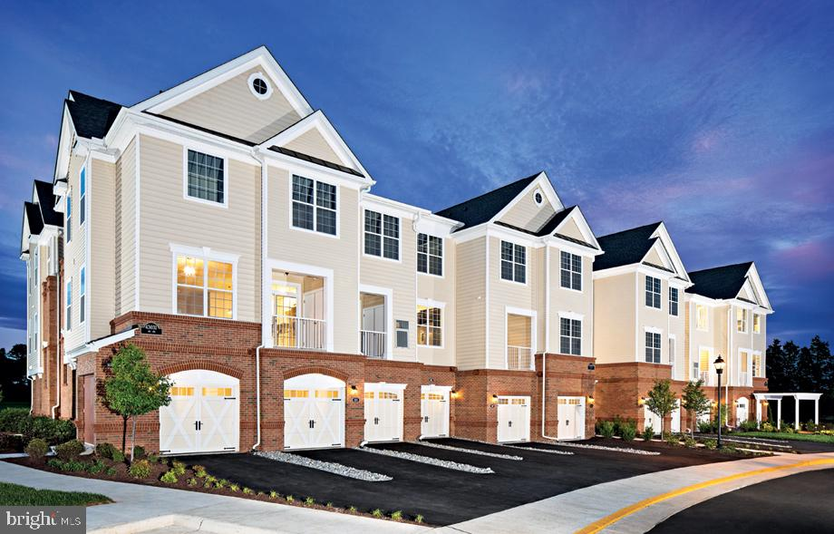 June 2020 Delivery facing tree save! NEW townhouse style, Dual Master bedroom condo featuring a den