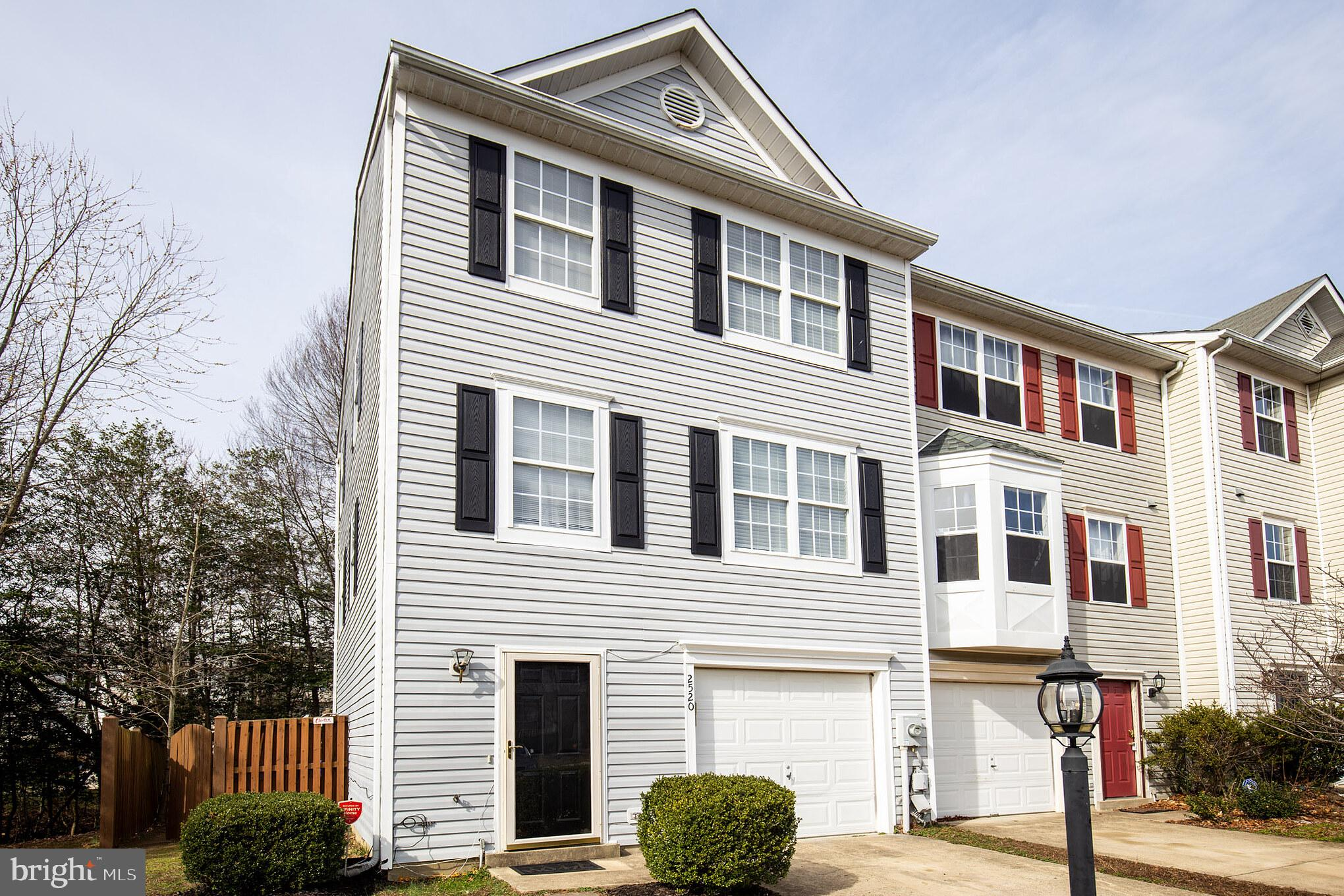 Immaculate end unit townhome featuring 3 bedrooms, 2 full bathrooms, and 2 half bathrooms in desirab
