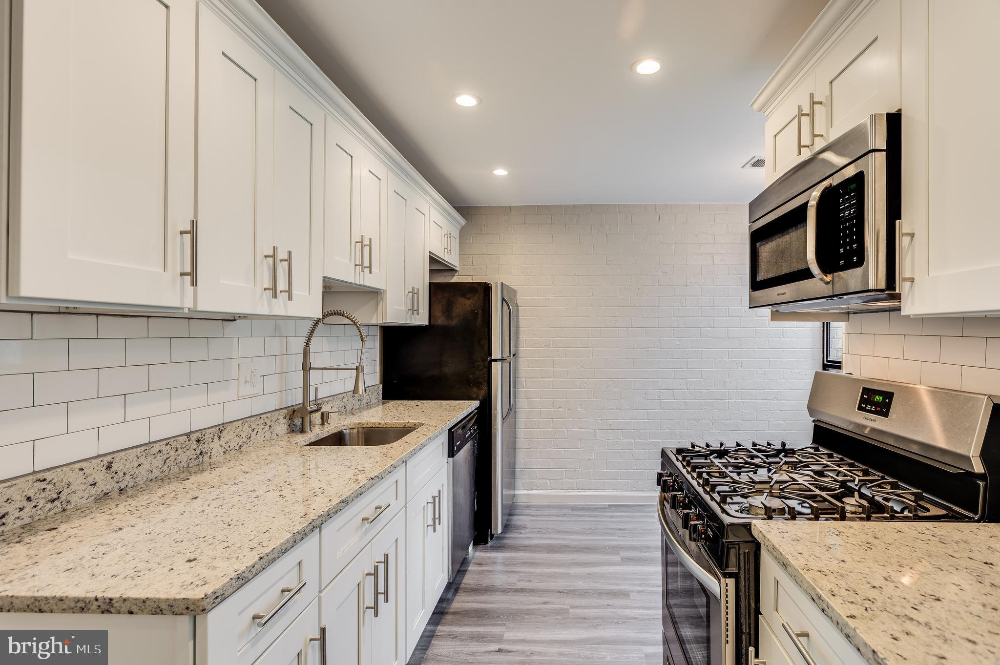 Fully Renovated 2 bed, 2 bath ground floor condominium in the Huntley Square community. This clean c