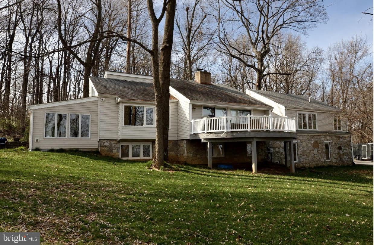 SOUGHT AFTER LOCATION! Searching for that contemporary home on 5 partially wooded acres with COMCAST