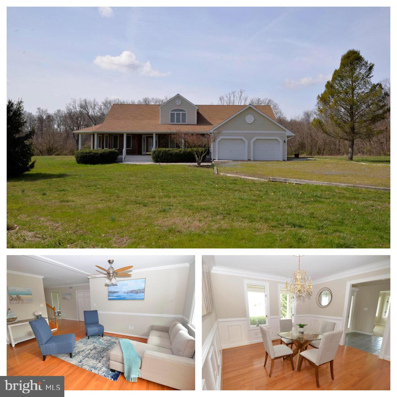 Beautiful custom two-story home situated on just over 1.5 acres surrounded by farmland and woods wit