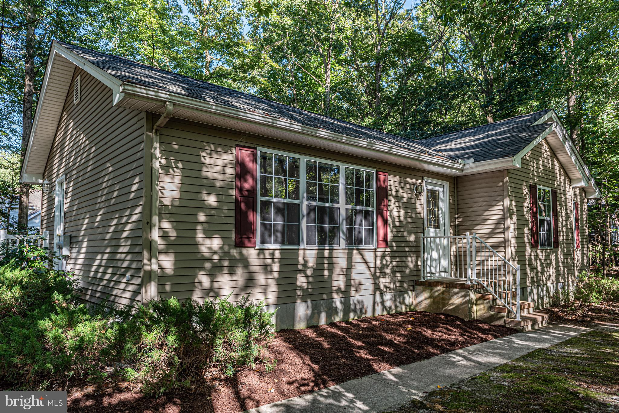 TAKE A LOOK AT THIS GREAT HOME!    JUST THE RIGHT SPACE FOR DOWNSIZING OR A GREAT STARTER HOME!  BRAND NEW ROOF OCT 2019.    One level living plus a  super location  in Ocean Pines for this  Charming Rancher...  its bright & airy & mostly updated!  Easy access out to South Gate of OP  with  3 BR/2 BA, screened Porch/new screening  & attached Storage.   Many new items throughout the home...Coastal style 100% waterproof  CORETEC flooring, New appliances/Kitchen Cabinets freshly painted with new hardware, new ceiling fans, fresh paint throughout the home, and a NEW Roof too!  Separate  Laundry rm &  Concrete Driveway with drive entry on Cannon.  Use either  Front or Side entry.   Floored Attic space too.  The corner lot is oversized and a buyer could even build a detached garage- see the plat!  The only thing missing is you!  Enjoy all of the amenities Ocean Pines has to offer... 5 pools, parks, walking/biking paths, Beach Club in Ocean City & parking there, golfing, tennis and so much more all just 6 miles to Ocean City!