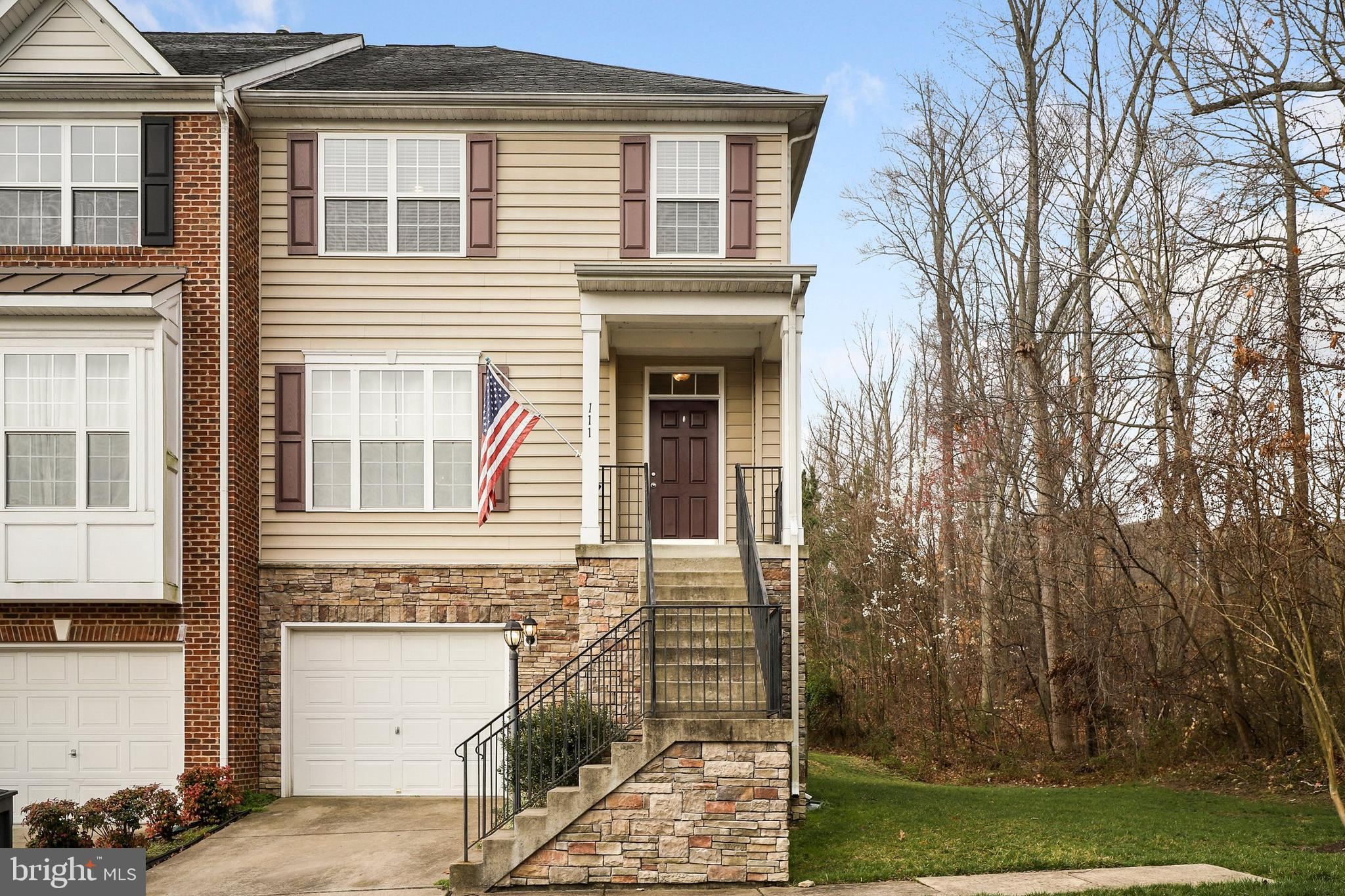 Be sure to see this 3 bedroom, 3/5 bath end unit townhome in Port Aquia! Entering this home you are