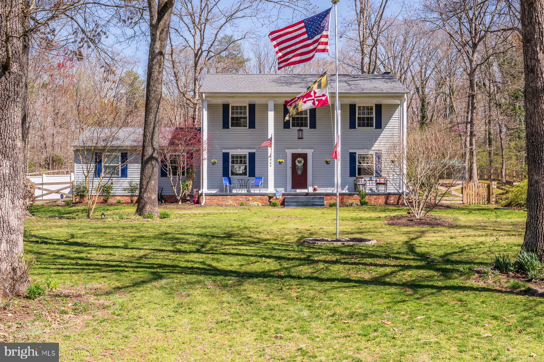 Welcome Home! This spacious four-bedroom, three bathroom colonial sits on over 1.5 acres with a full