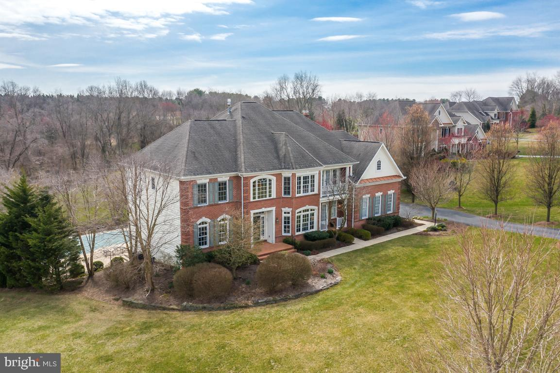 This Five Bedroom, Four and Two Half Bath home in Pine Brook Farm was Designed for both Living and E