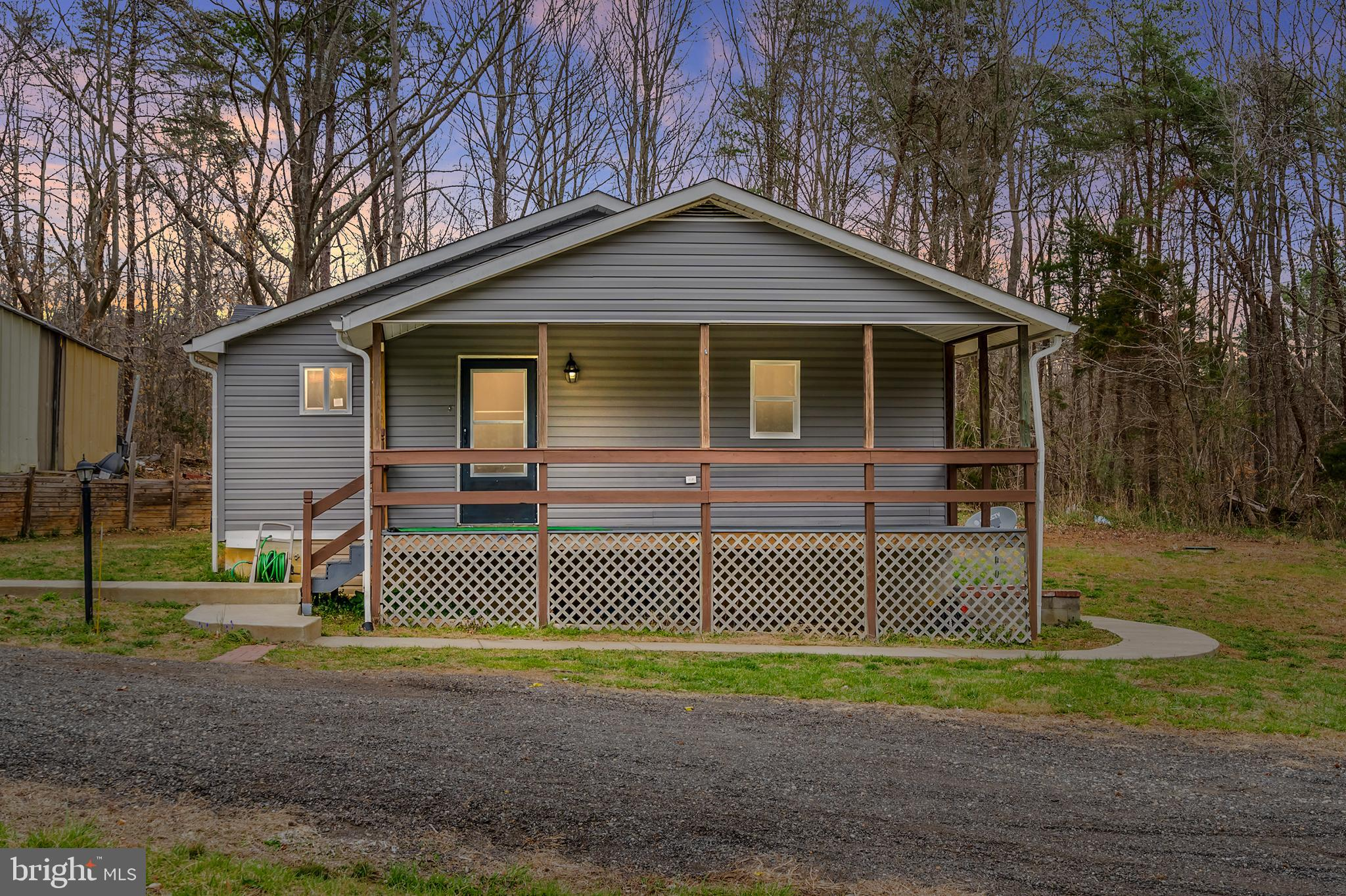 Super cozy bungalow with many upgrades that will exceed every expectation!  Large one acre lot.  Enj