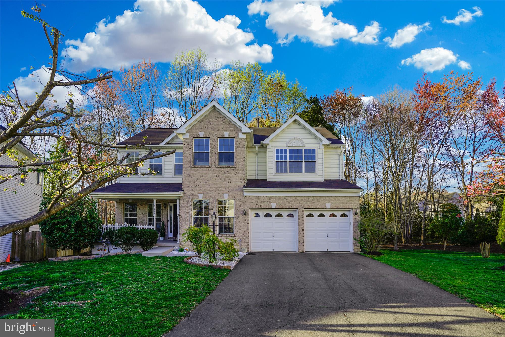 COME AND JOIN US FOR A VIRTUAL OPEN HOUSE THIS SUNDAY MAY 31ST AT 1PM AT THIS BEAUTIFUL COLONIAL HOME MINUTES FROM COMMUTER ROUTES! LOCATION LOCATION LOCATION!  WITH A QUICK 2 MILES TO 95 AND 4 MILES TO THE VRE THIS IS A COMMUTERS DREAM! PLENTIFUL SHOPPING & RESTAURANTS WITHIN MINUTES AT THE POTOMAC MILLS MALL!  COME AND SEE THIS WONDERFULLY UPGRADED LARGE 5 BEDROOM HOME IN THE BOUTIQUE NEIGHBORHOOD OF MADISON FARM! BEAUTIFUL DARK LTV (LUXURY VINYL TILE) STRETCHES FROM THE OPEN FOYER INTO THE LIVING AND DINING ROOM AREAS. THE OVERSIZED FAMILY ROOM  WITH GAS FIREPLACE IS CONNECTED TO THE BRIGHT AND WELCOMING KITCHEN. HERE YOU WILL FIND GOURMET STAINLESS APPLIANCES, ABUNDANT WHITE CABINETS AND CORNER PANTRY! A MAIN LEVEL OFFICE CAPS OFF OUR MAIN LEVEL. THE  FRESH LIGHT GRAY PAINT THROUGHOUT THE MAIN FLOOL EXTENDS TO THE UPPER LEVEL WHERE YOU WILL FIND 4 GENEROUS BEDROOMS AND A HUGE MASTER WITH HIS AND HERS BAY CLOSET PLUS AN EN SUITE BATH WITH UPGRADED FLOORING, FRAMED MIRROR AND SOAKING TUB/SHOWER.  THE LOWER LEVEL OF THIS HOME IS FANTASTIC FOR ENTERTAINING WITH A T.V. AREA, WET BAR, GAME ROOM, DEN AND MORE!  OUT BACK IS AN EXPANSIVE DECK AND A GORGEOUS VIEW OF TREES, A PERFECT PLACE TO RELAX!  NEW ROOF, NEW CARPET UPPER LEVEL, PLUS MANY OTHER UPGRADED FEATURES!  PRIVATE REAR YARD, FRONT PORCH AND PRIME CUL DE SAC LOCATION!   YOU WILL NOT BE DISAPPOINTED! VIRTUAL OPEN HOUSE VIDEO TOUR on our Facebook page - Stephane Czajkowski and Associates! (SCAArealtors)